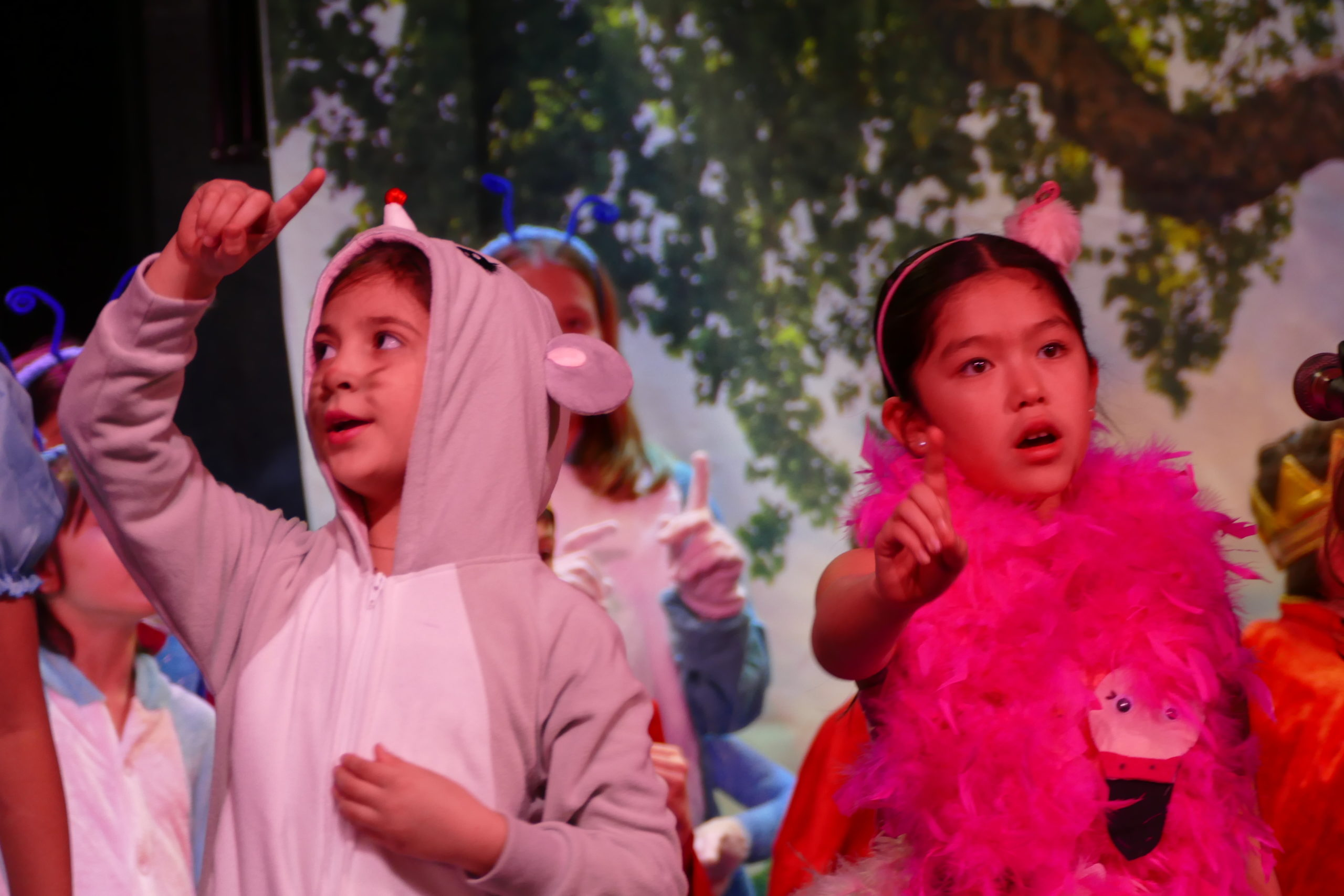"Fourth-graders at Our Lady of the Hamptons School, including Phoebe Sosa and Scarlett Macias, presented a special assembly ""Alice's Adventures with Idioms,"" a play based on English grammar in song and dance."