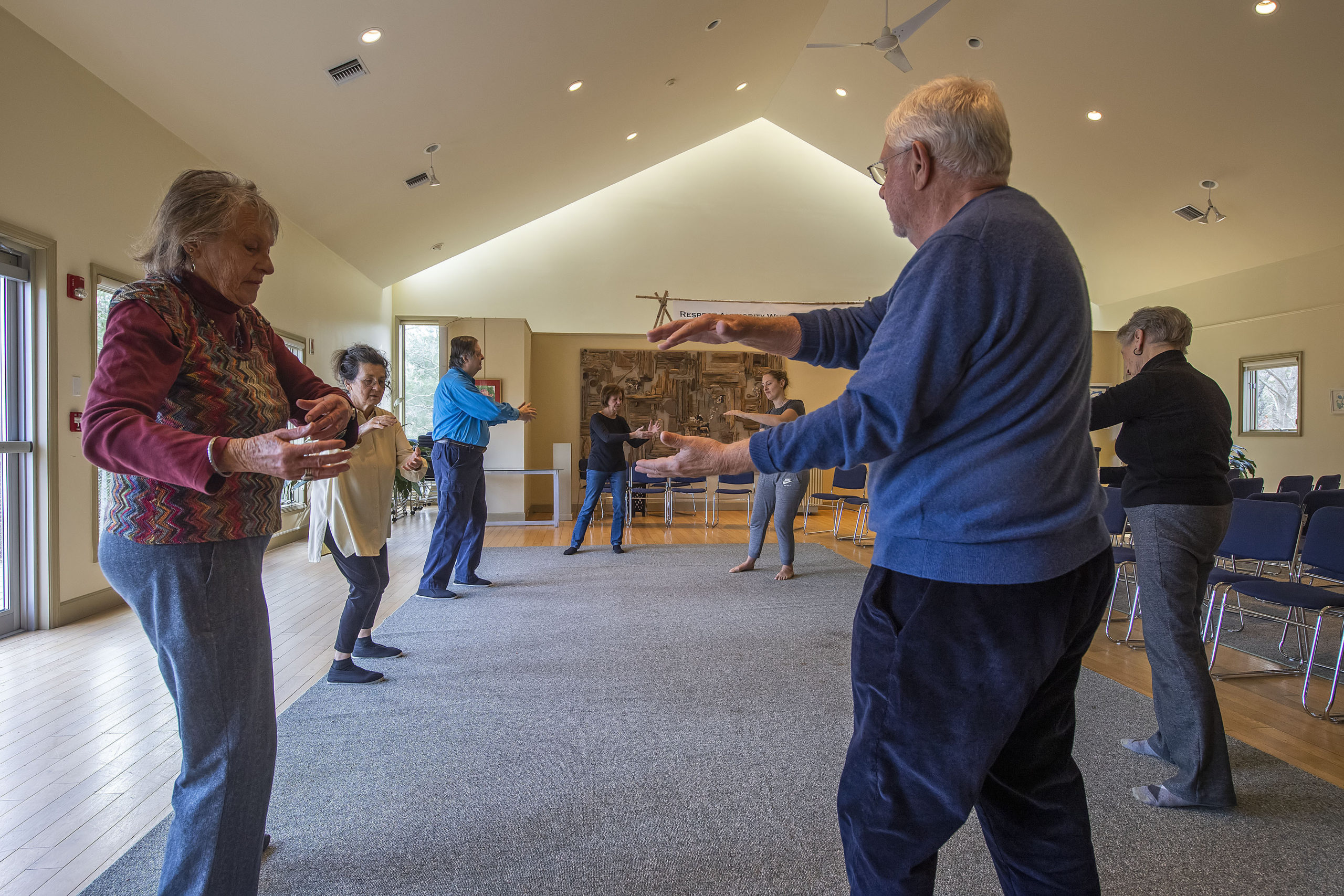 Instructors Tina Curran and Steve Flores, second and third from left, lead a small group as they practice Qi Gong at the Universalist Unitarian Church of the Hamptons on Sunday, January 12.  MICHAEL HELLER