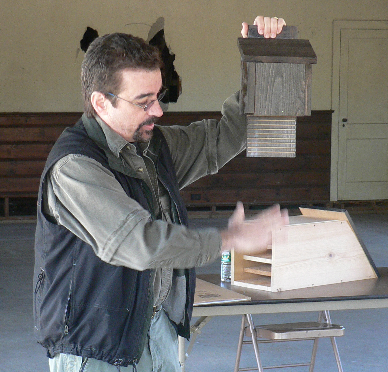 LIU professor and bat biologist Dr. Bill Schutt shows some examples of bat houses and how they are utilized by bats as roosting sites.