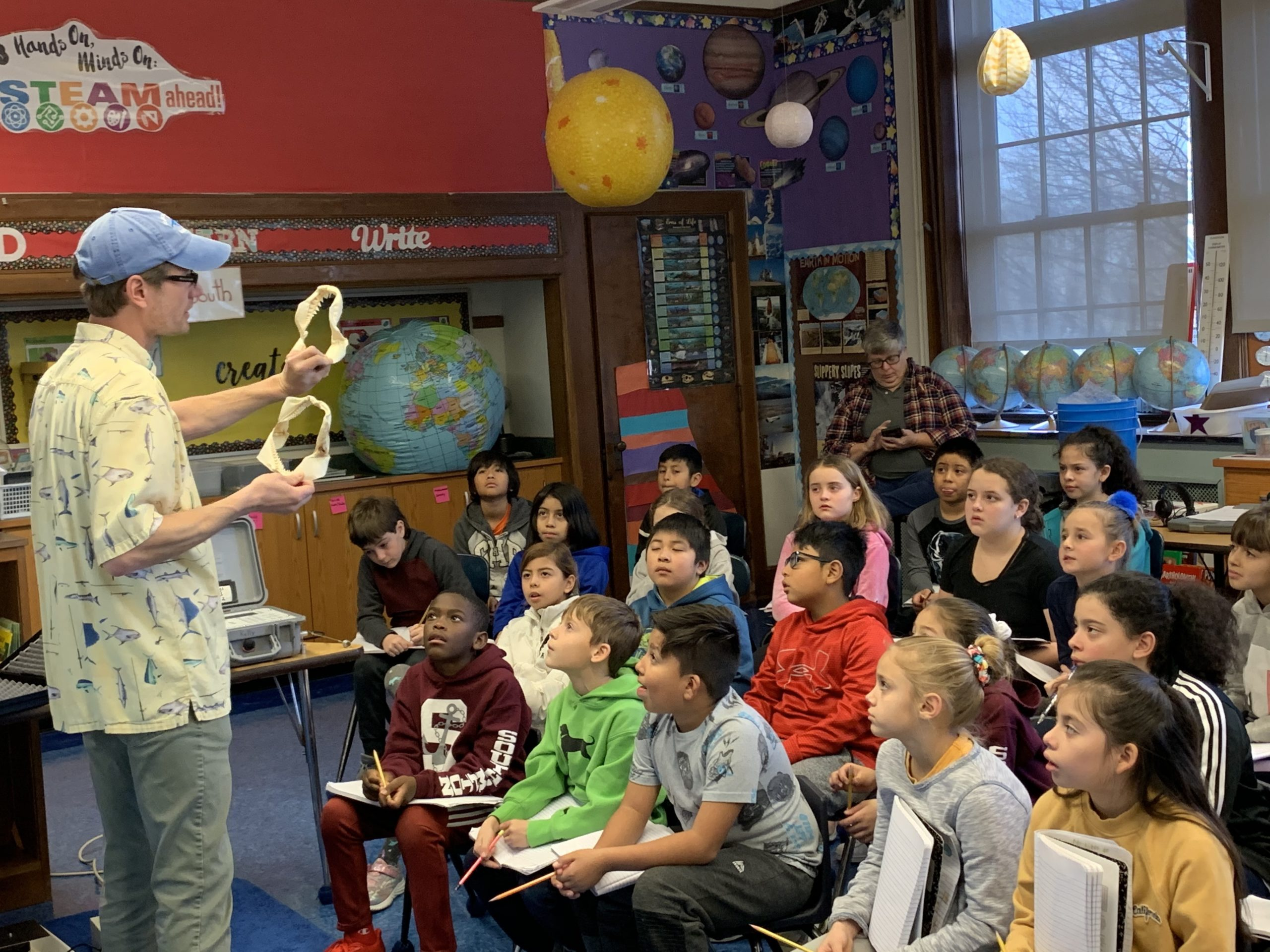 Southampton High School marine science teacher Gregory Metzger spoke to third- and fourth-grader about his research on sharks.