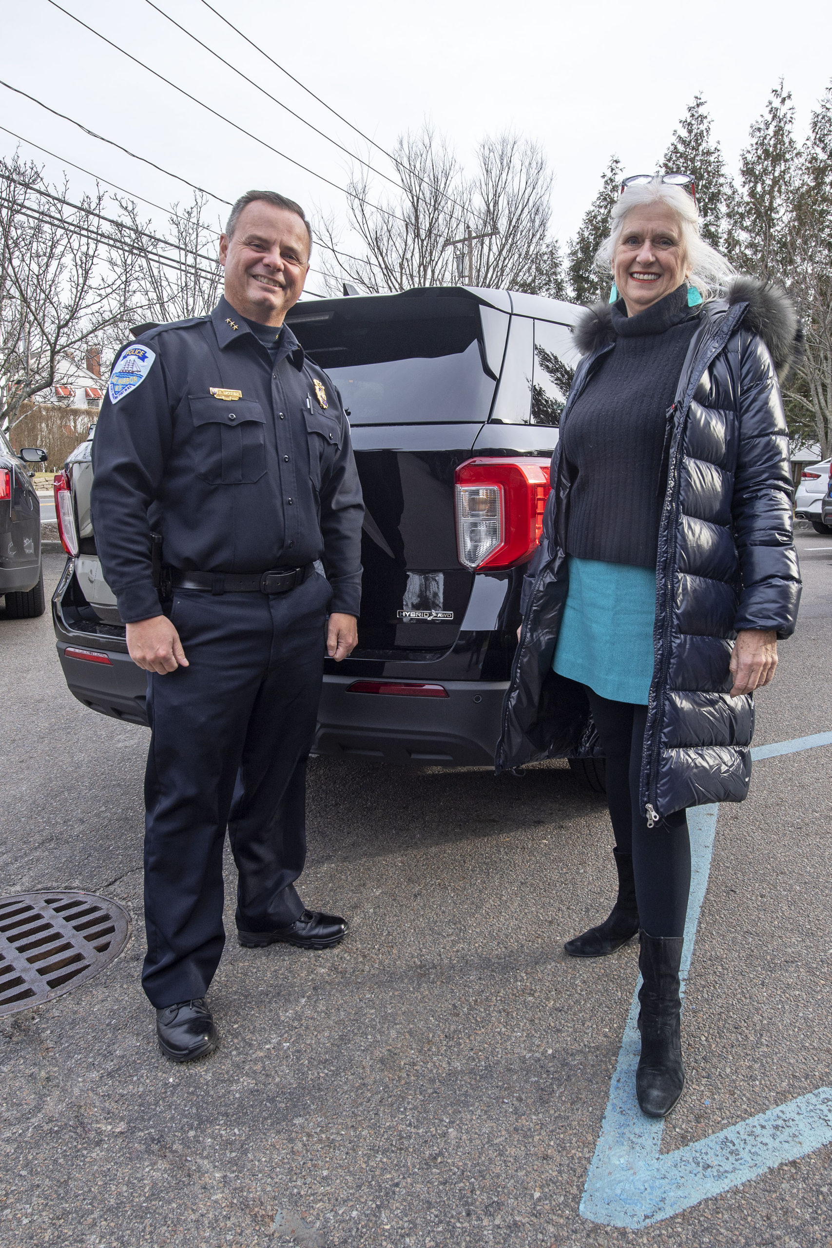 Sag Harbor Village Mayor Kathleen Mulcahy and Sag Harbor Village Police Chief Austin J. McGuire with the village's first hybrid SUV.
