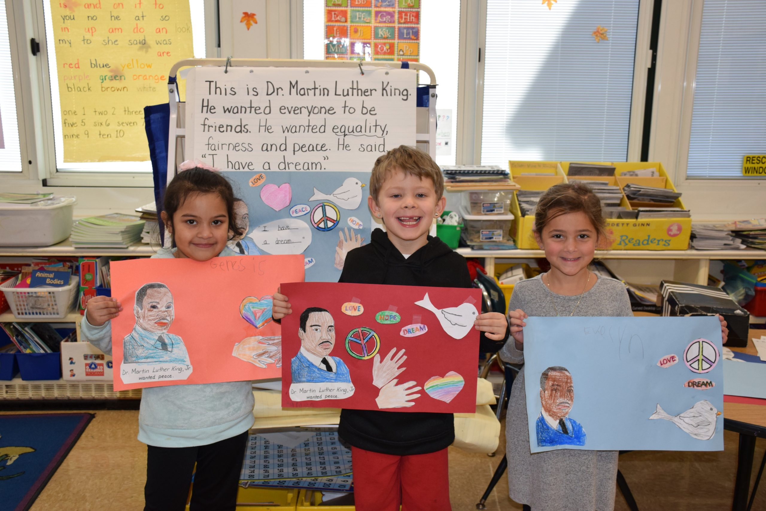 Patricia DeCicco's kindergartners at Westhampton Beach Elementary School learned about the life of Dr. Martin Luther King Jr. on Jan. 17. Following the discussion, the students, including, from left, Genesis Lopez Castellanos, Raiden Komarovskij and Evelyn Bennett,  designed posters depicting what they learned about the civil rights leader.