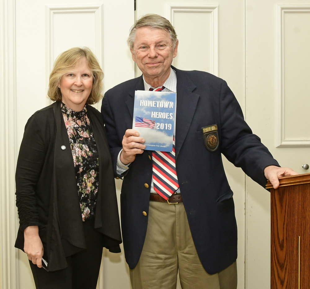 Susan Berdinka, technical services librarian at the Westhampton Free Library, presented Commander Thomas Hadlock with the American Legion Post 834 Hometown Hero book during the culimination ceremony for the Hometown Heroes Program.