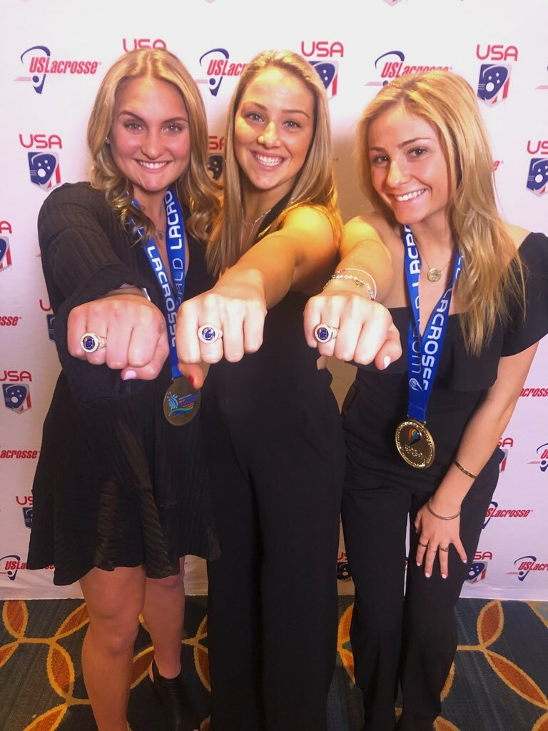 Long Island players, from left to right, Eastport/South Manor's Kasey Choma, Wantagh's Ally Murphy and Isabelle Smith of Westhampton Beach showing off their championship rings.