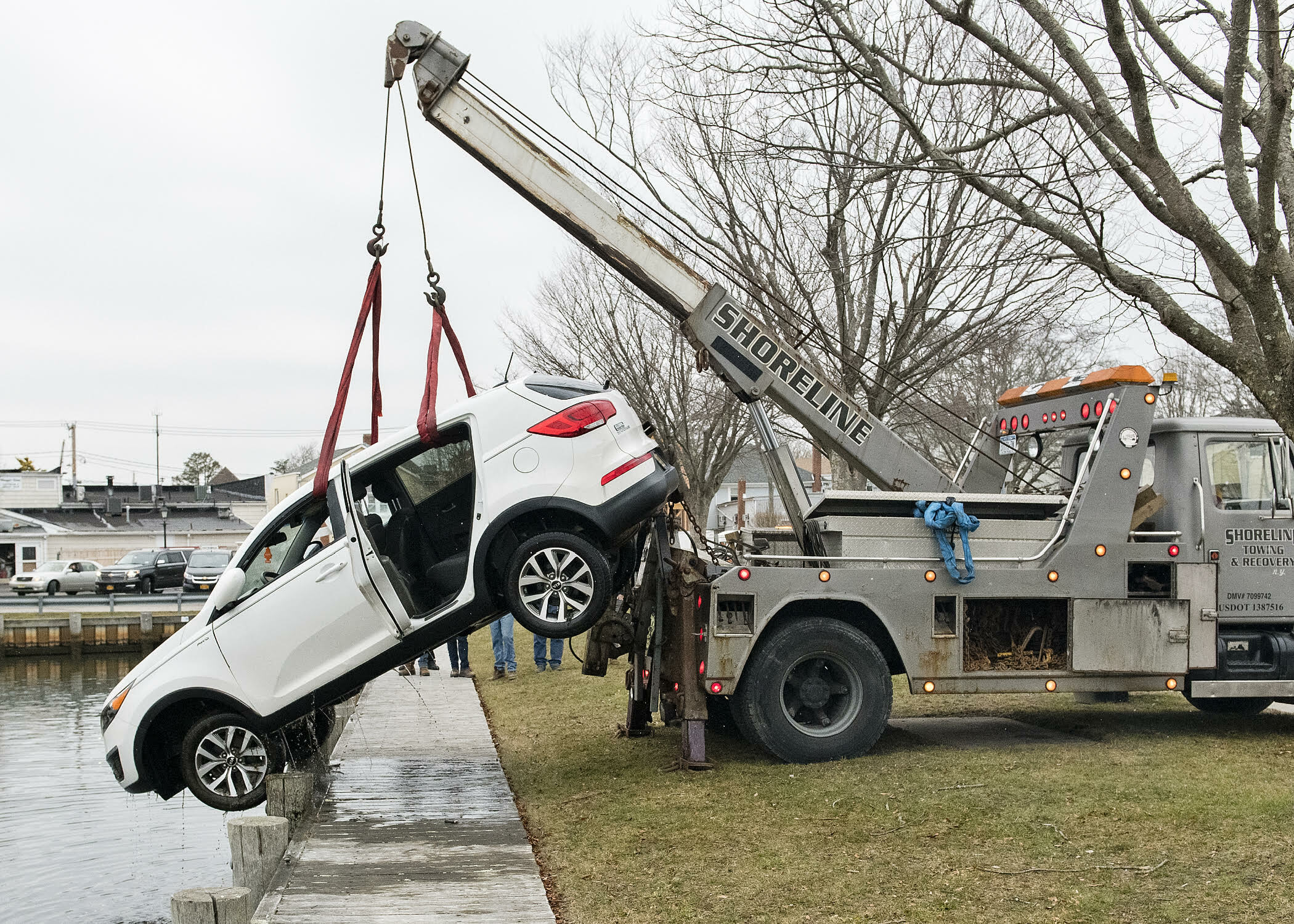 A truck from Shoreline Towing & Recovery was able to lift the vehicle onto shore.