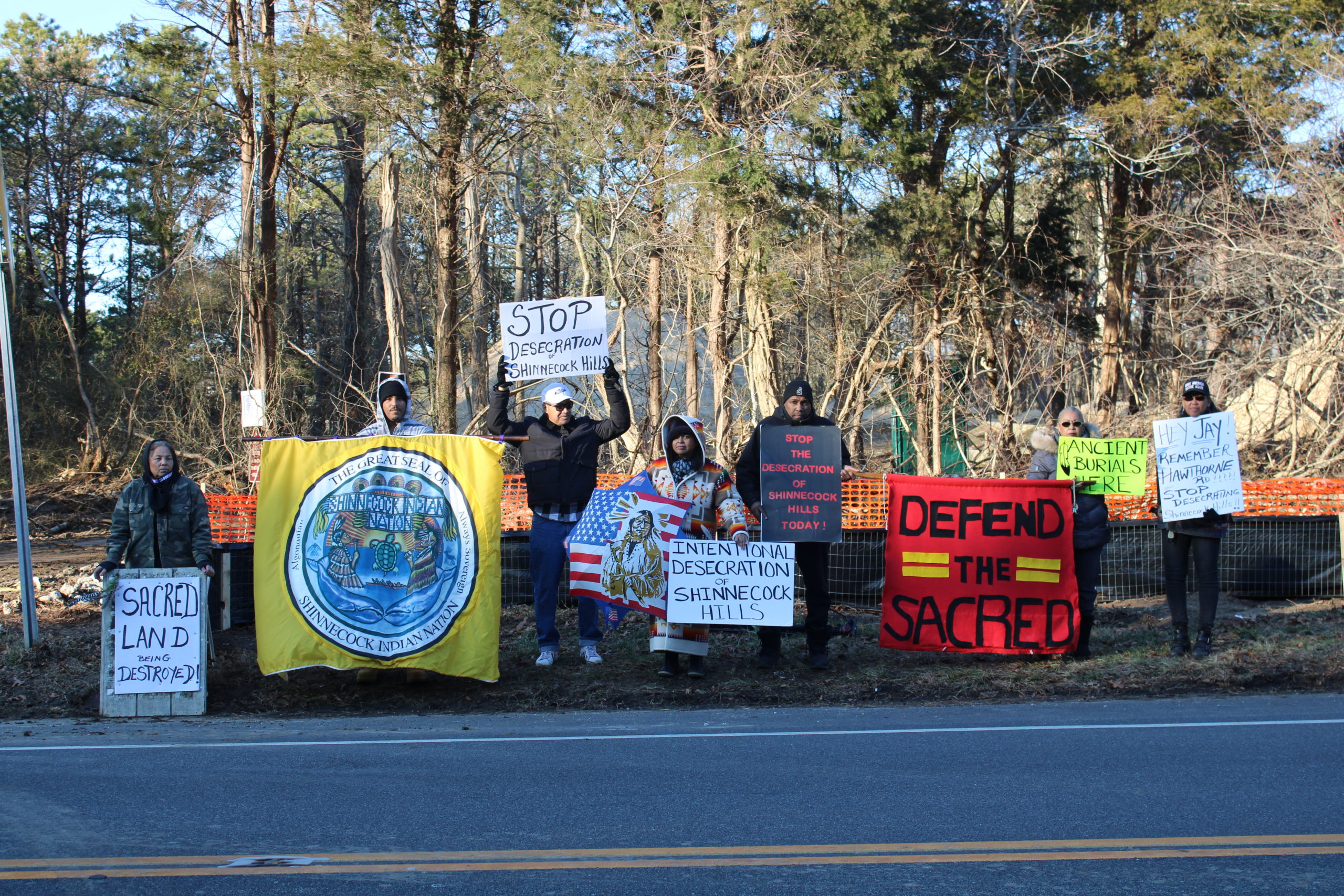 Shinnecock Tribal members gather on Montauk Highway to raise awareness about the home being built on Sugar Loaf.
