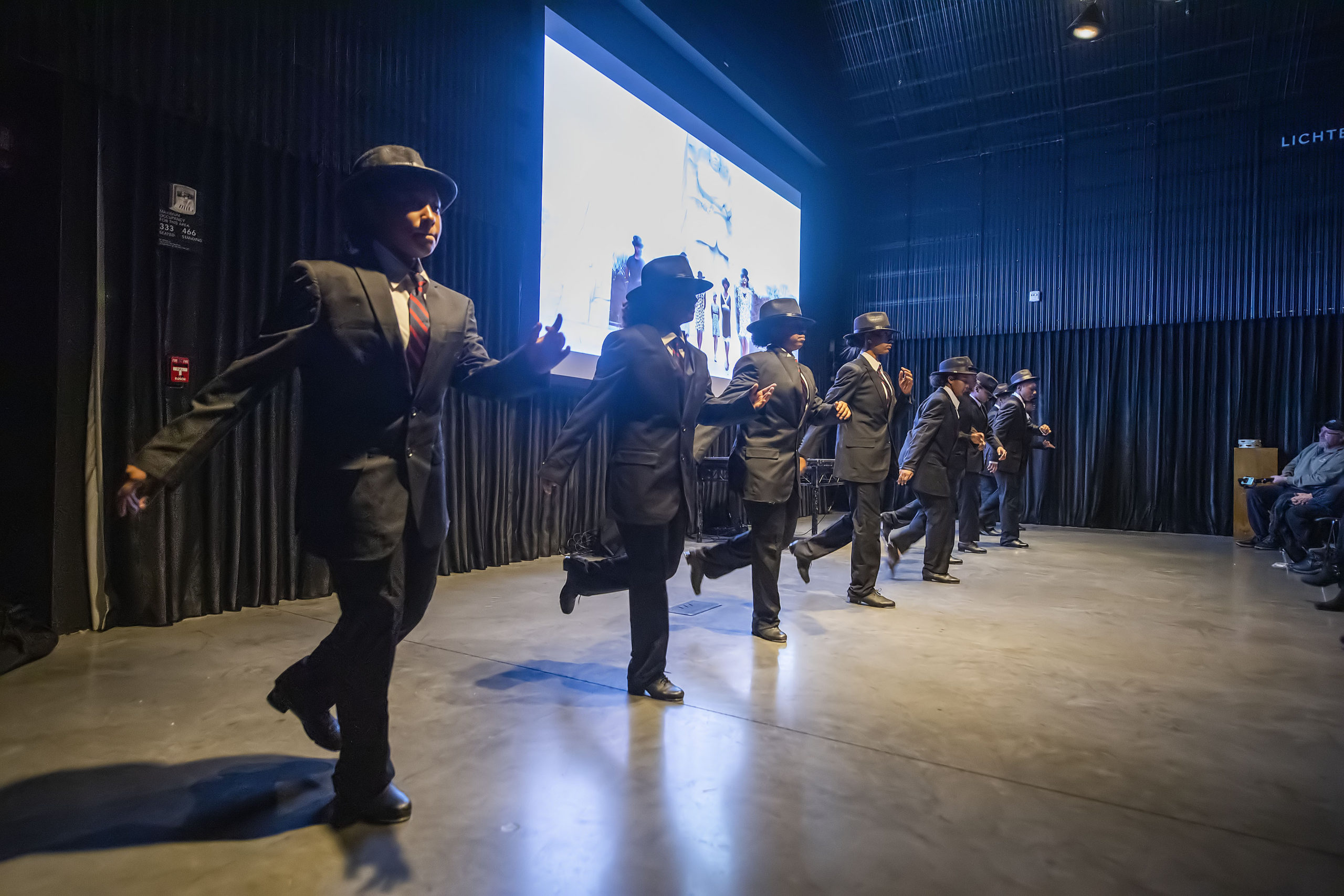 Dancers from the Edge School of the Arts and A*tone*ment perform in synchronization with a series of short films during the