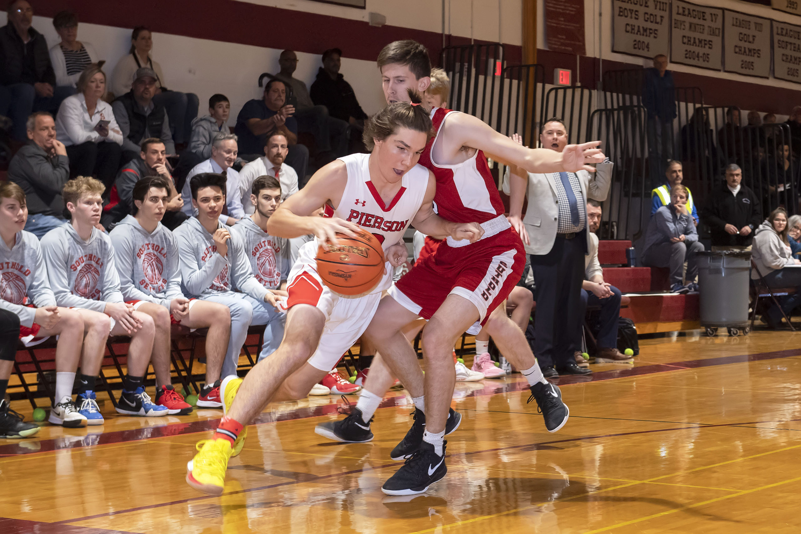 Pierson's Henry Brooks drives on a Southold defender.