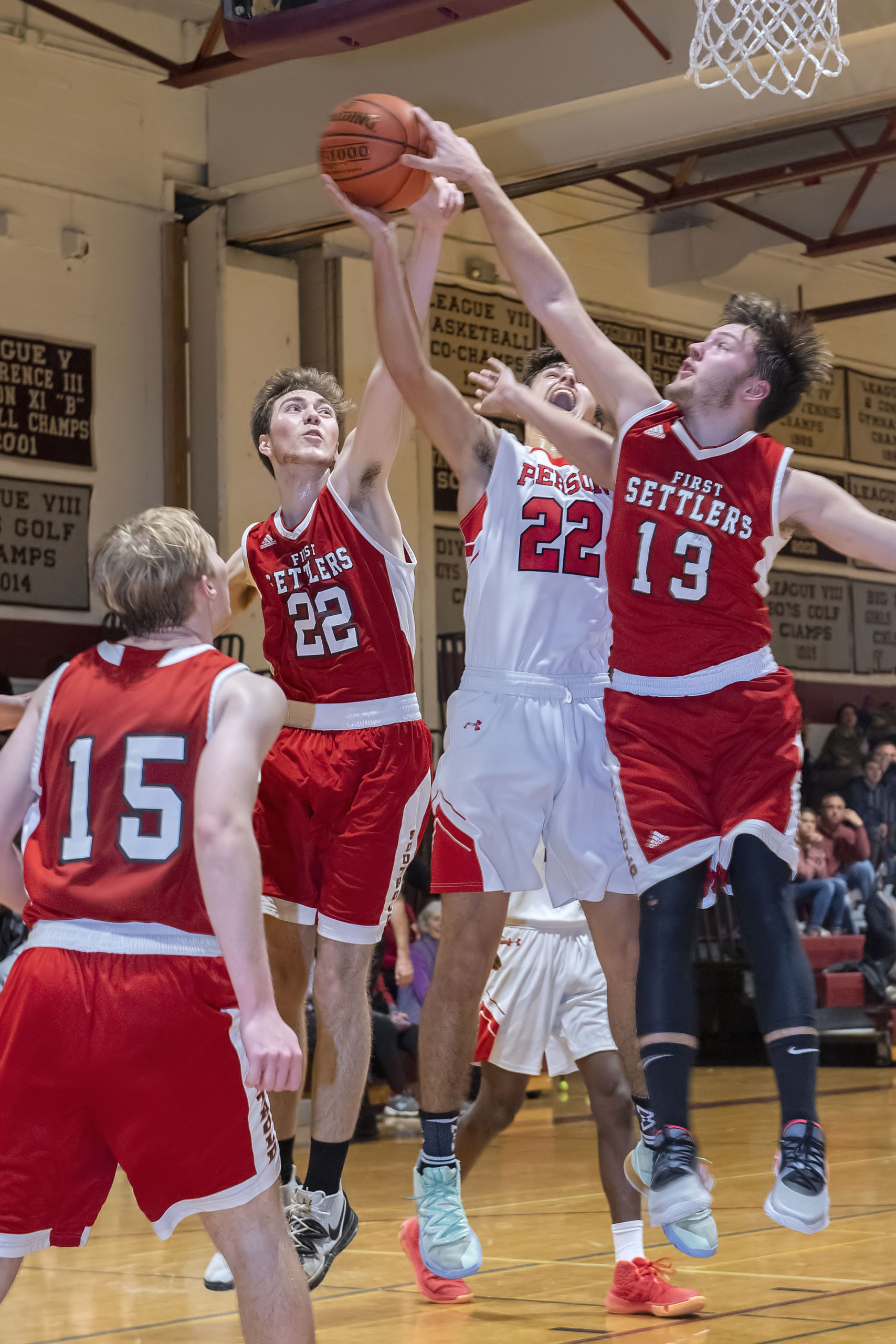 Whaler Harry Cowen is double-teamed by a pair of Southold defenders.
