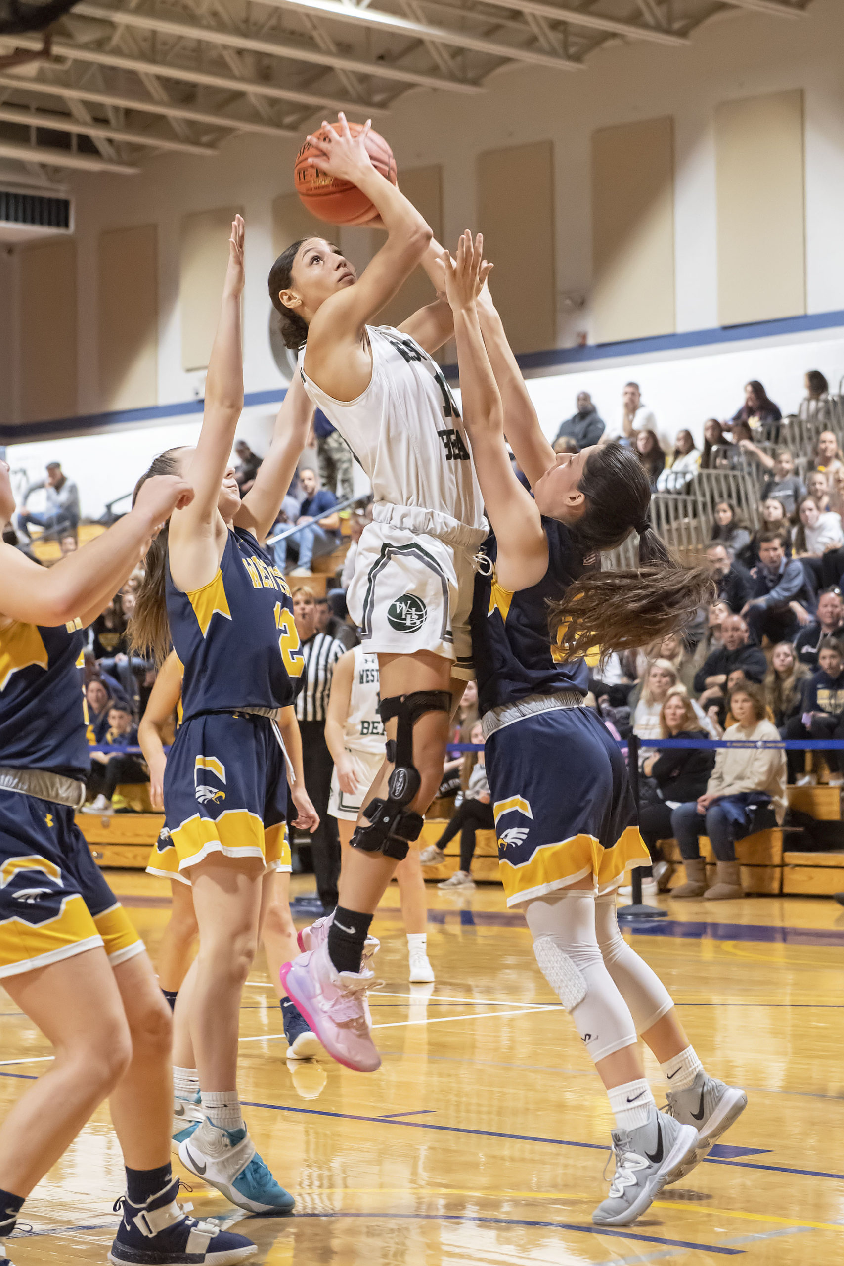 Westhampton Beach senior Layla Mendoza goes up a against a few West Babylon defenders.
