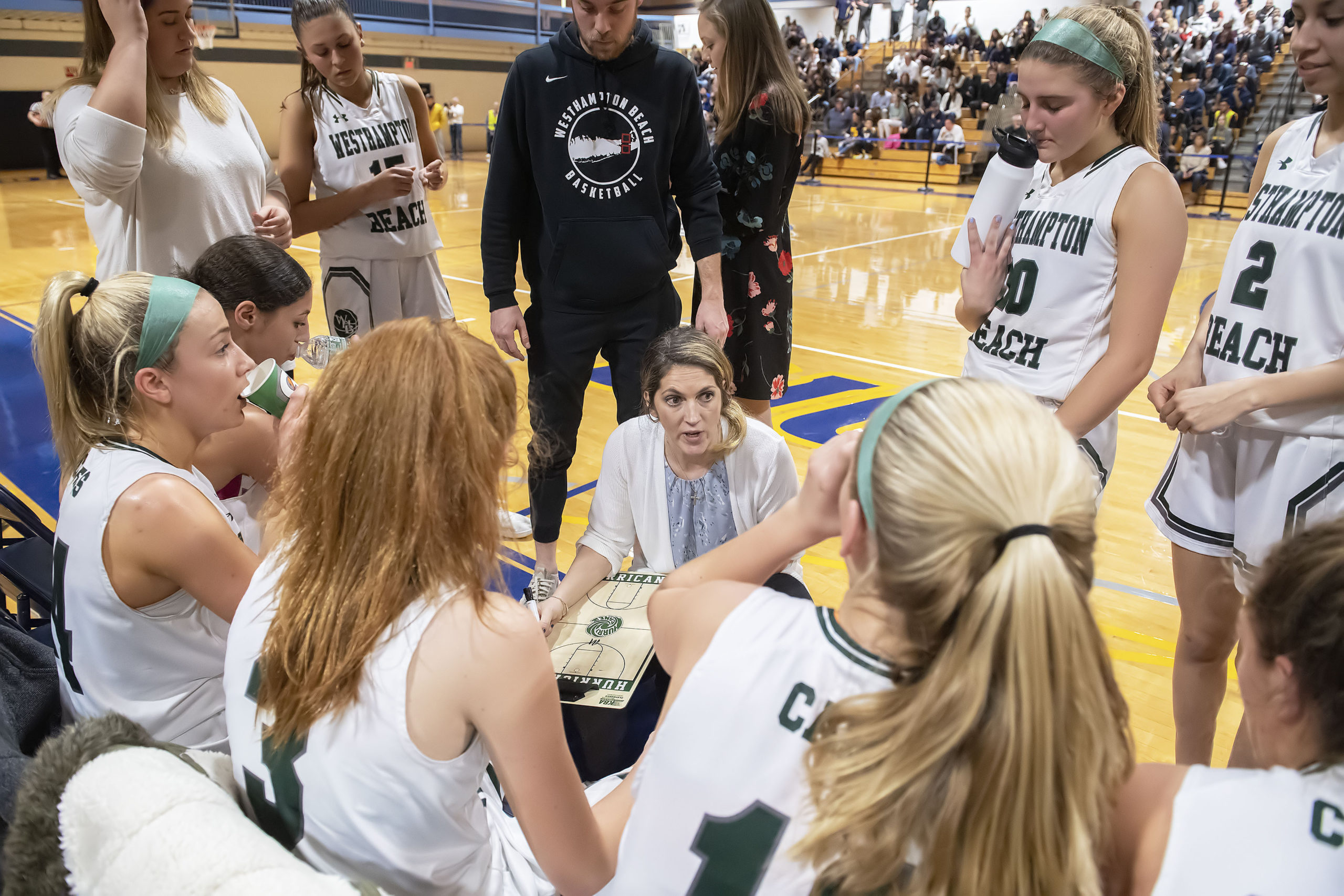 Westhampton Beach head coach Katie Peters speaks to her players on Tuesday night.