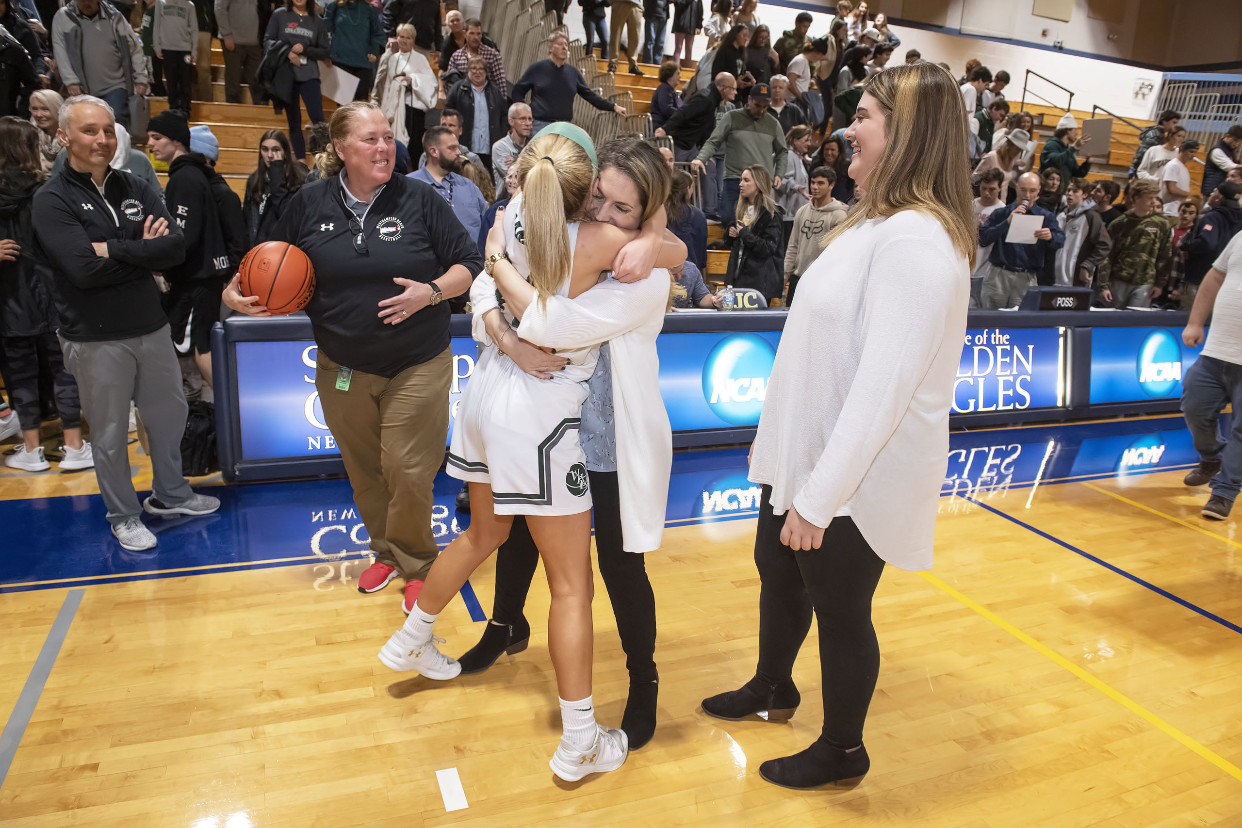 Westhampton Beach senior Isabelle Smith and head coach Katie Peters embrace each other after a hard fought victory for the county title on Tuesday night.