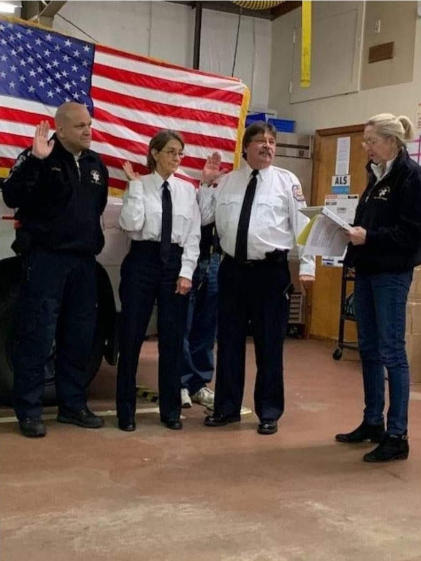 Adele Kristensen, right, swears in Southampton Town Volunteer Ambulance Second Assistant Chief Guy Sparks, First Assistant Chief Linda Forster and Chief Tom Nanos.
