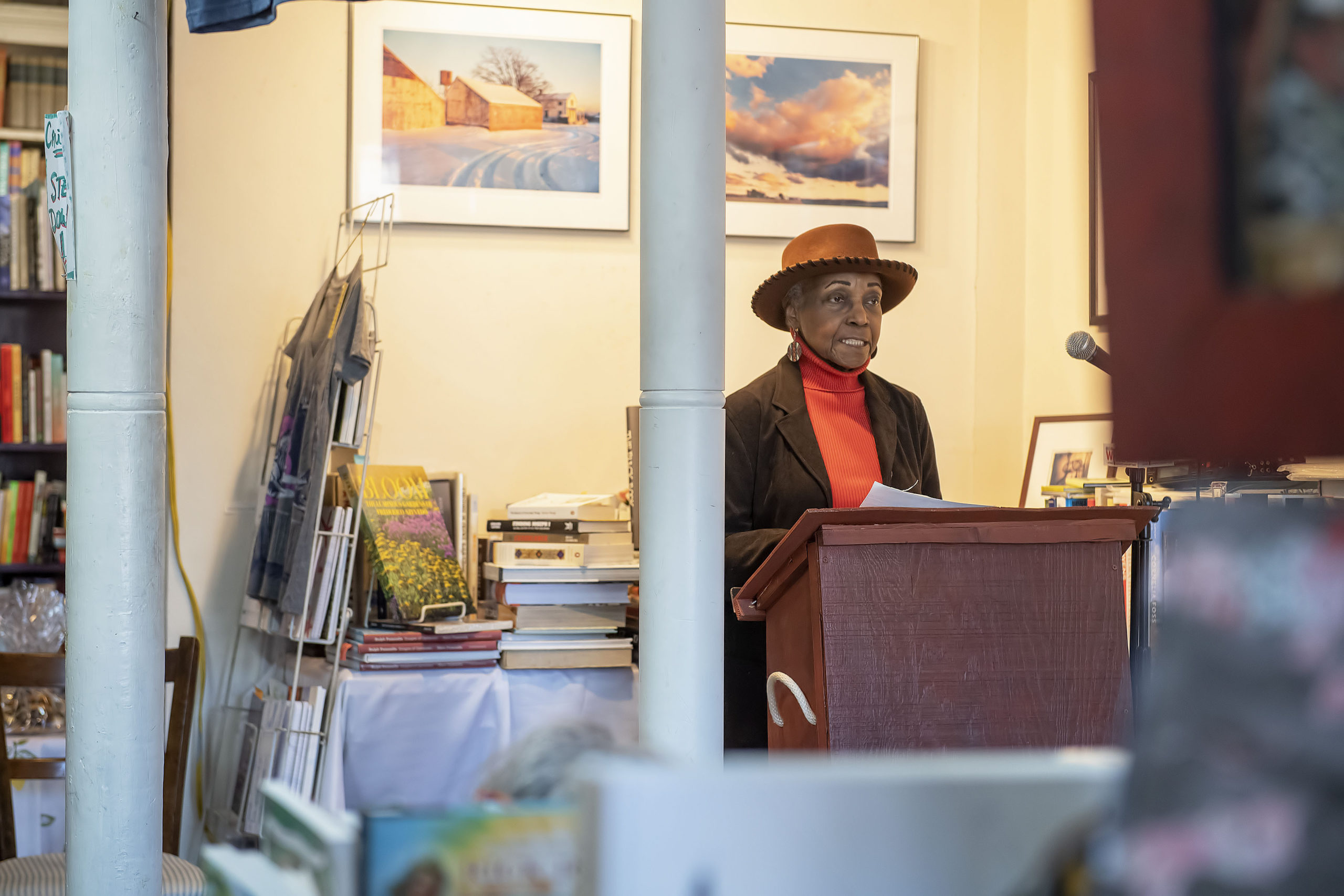 Gloria Brown reads reads a folk tale by Zora Neale Hurstion during the 2020 African-American Read-In that was held in conjunction with he John Jermain Memorial Library at Canio's Books on Saturday.  MICHAEL HELLER