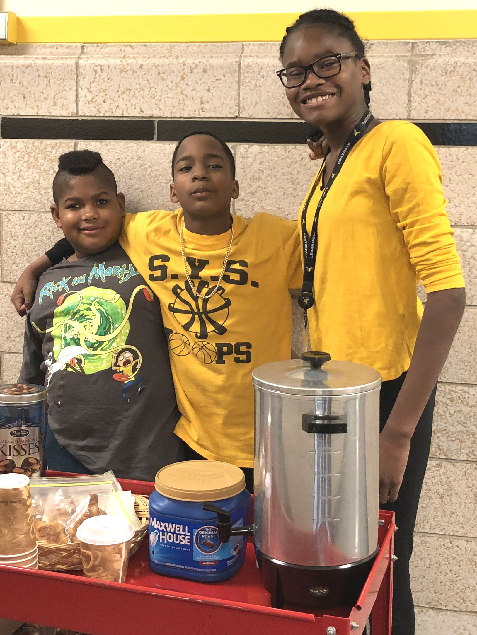 Nigel Abercrombie, Marques Thomas and MaKayla Pinckney serve up goodies from the school's Honey Hive Cafe.