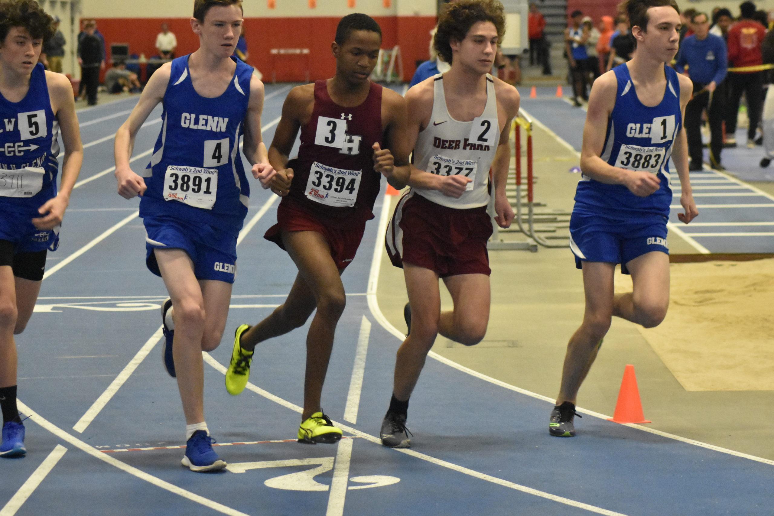 East Hampton's Amari Gordon jockeys for position at the start of the 1,000-meter race.