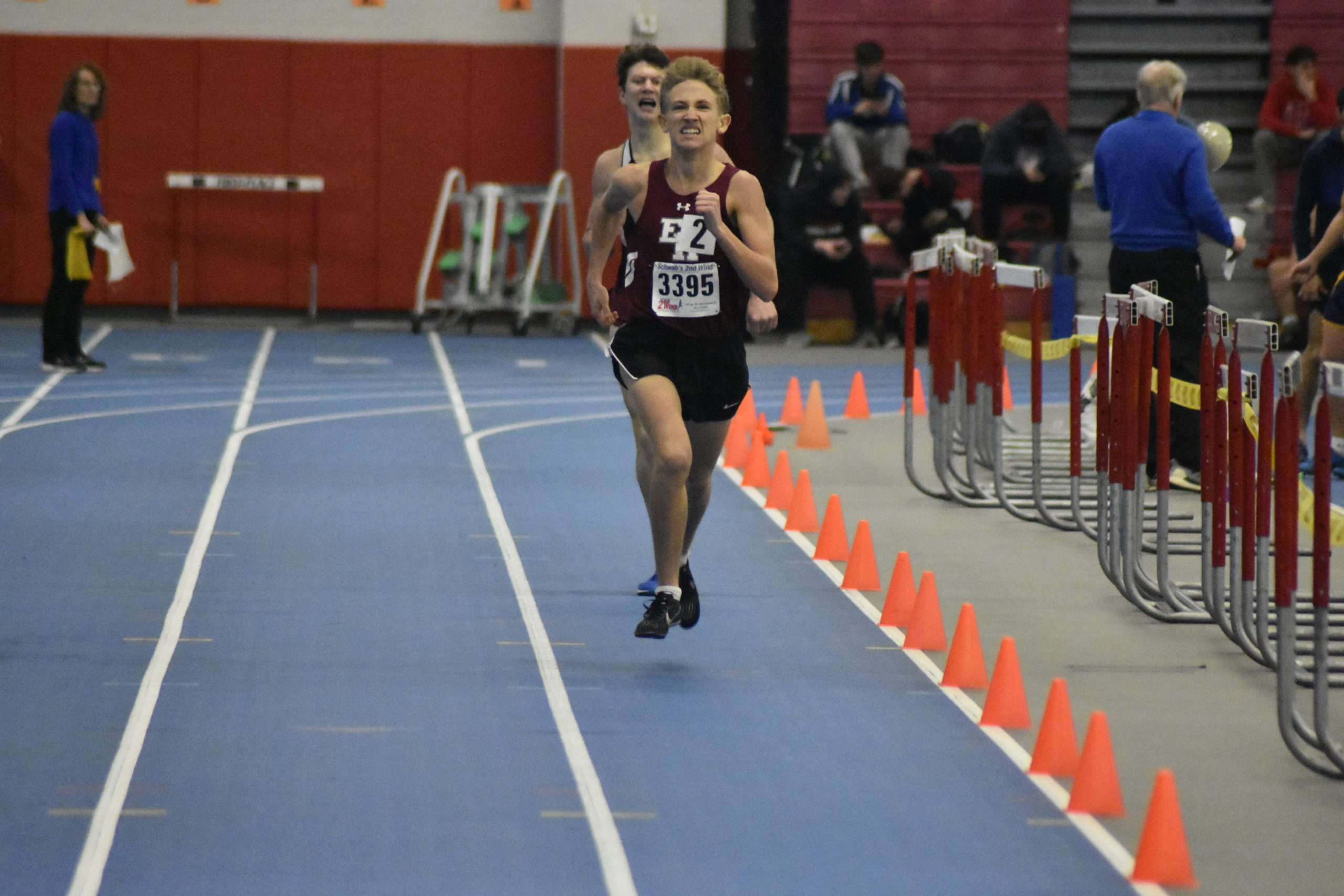 Pierson's Ben McErlean surpasses Southampton's Griffin Schwartz to win the second heat of the 1,000-meter race. McErlean wound up placed fourth overall.
