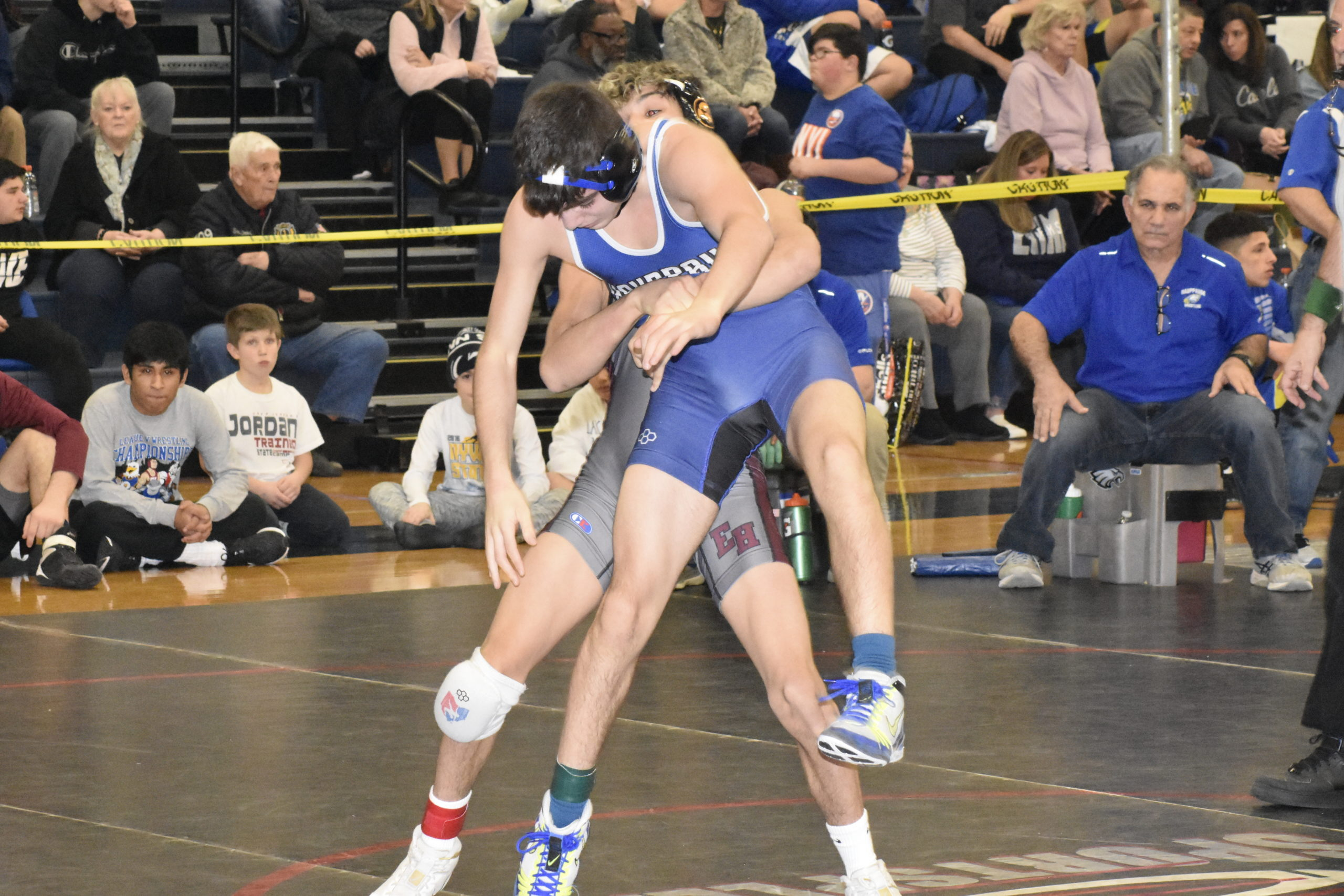 East Hampton's Santi Maya battles with Hauppauge's Frank Volpe in the semifinals.