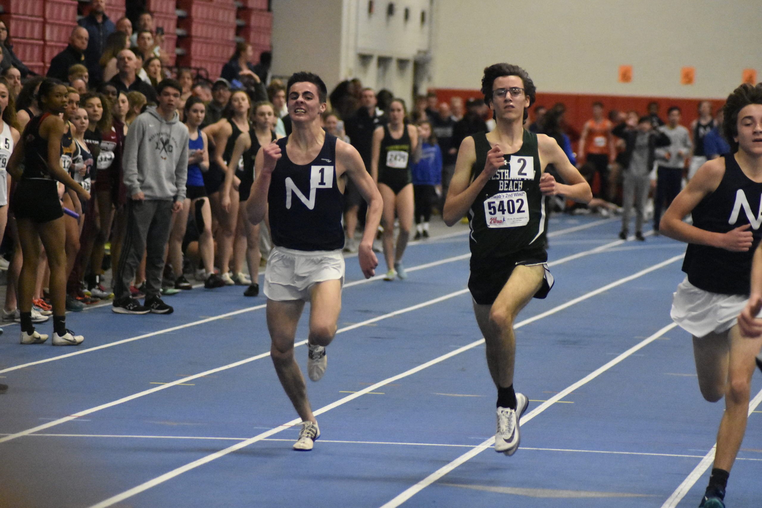 Northport's Thomas Fodor and Gavin Ehlers of Westhampton Beach down the final stretch of the 3,200-meter race.