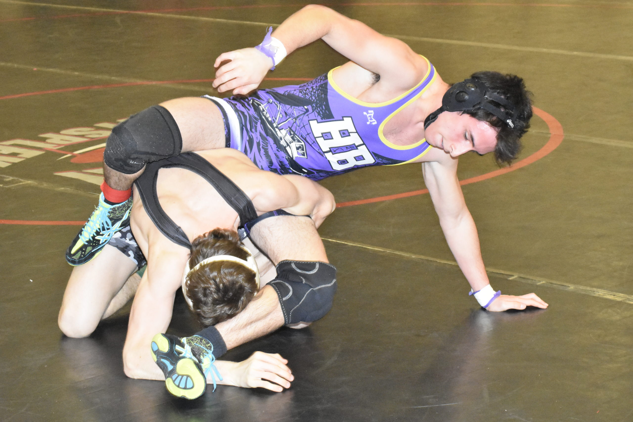 Nick Pacheco of Hampton Bays battles with Babylon's Jack DeVoe. Pacheco lost, 5-2, falling a round short of placing.