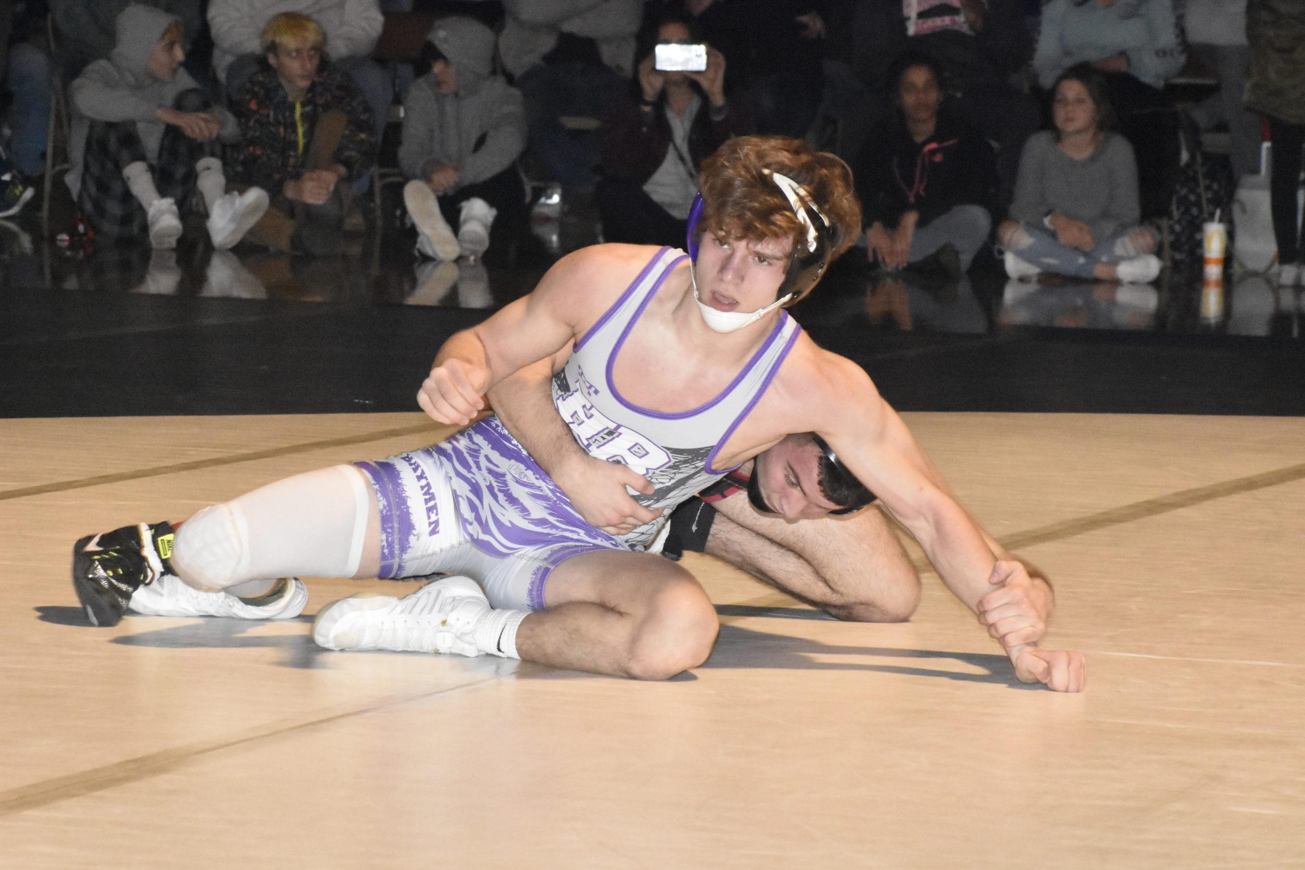 Hampton Bays junior River Orlando battled Mount Sinai's Mike O'Brien in the county final.