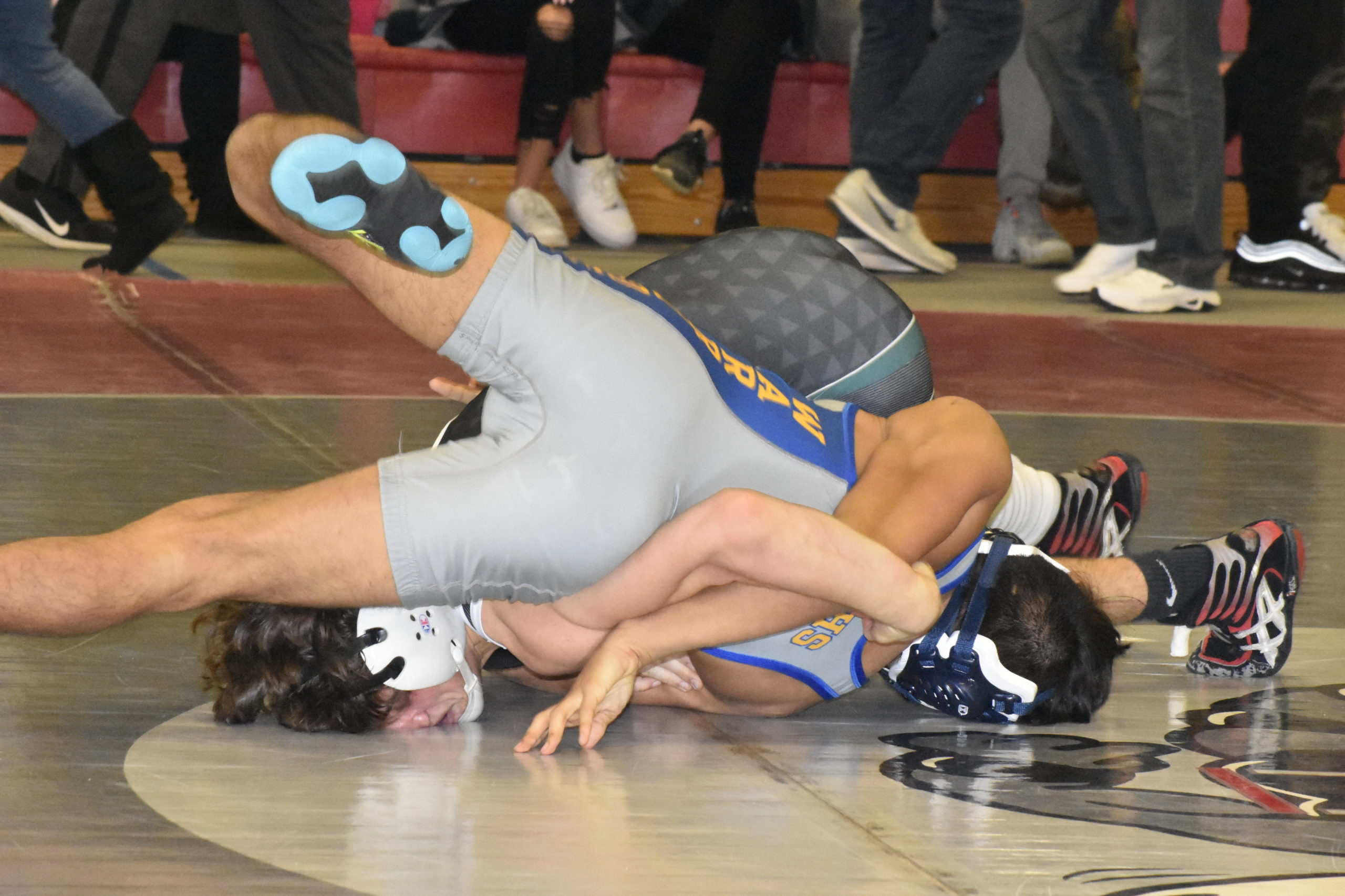 Westhampton Beach senior Jay Montagna tries to pin Sean Martinez of Comsewogue.