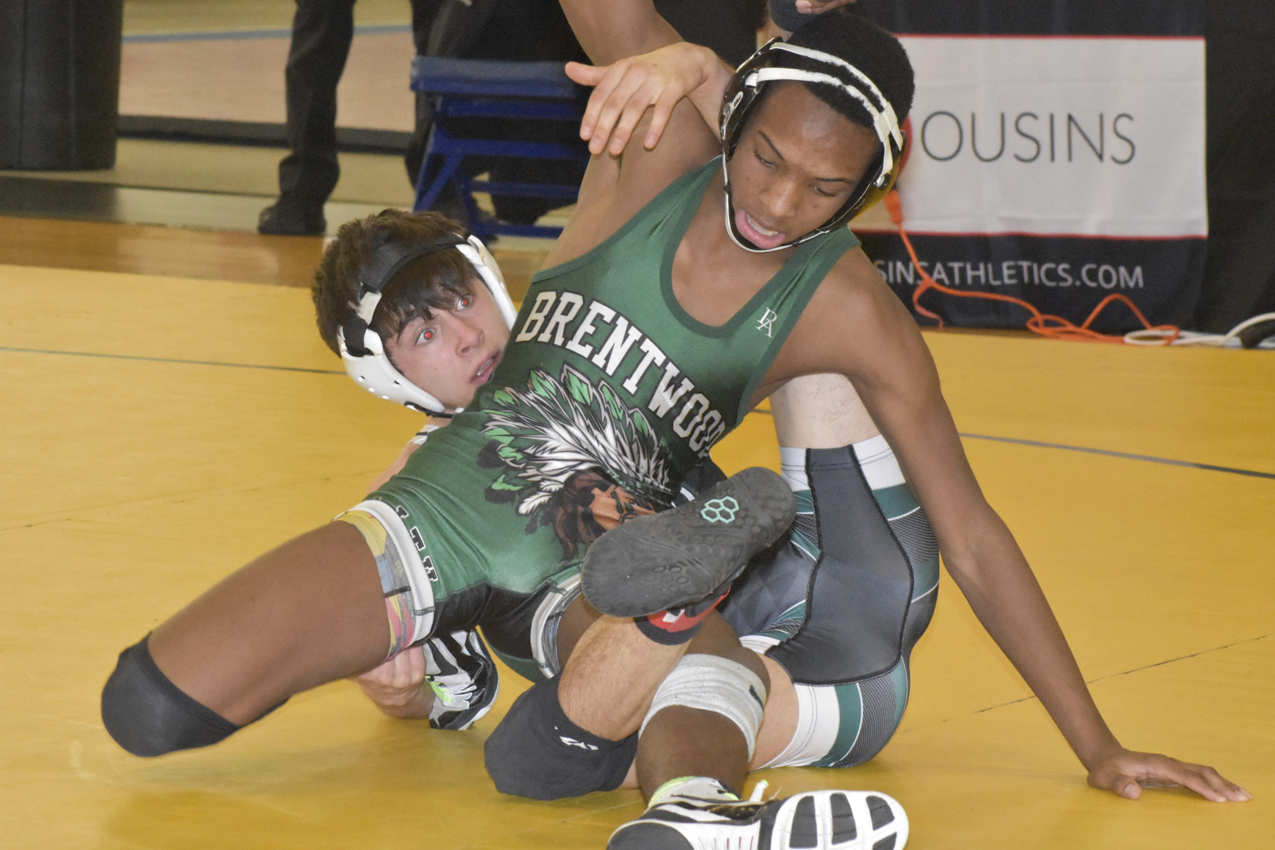 Will Zaffuto of Westhampton Beach tries to take down Devin Walker of Brentwood.