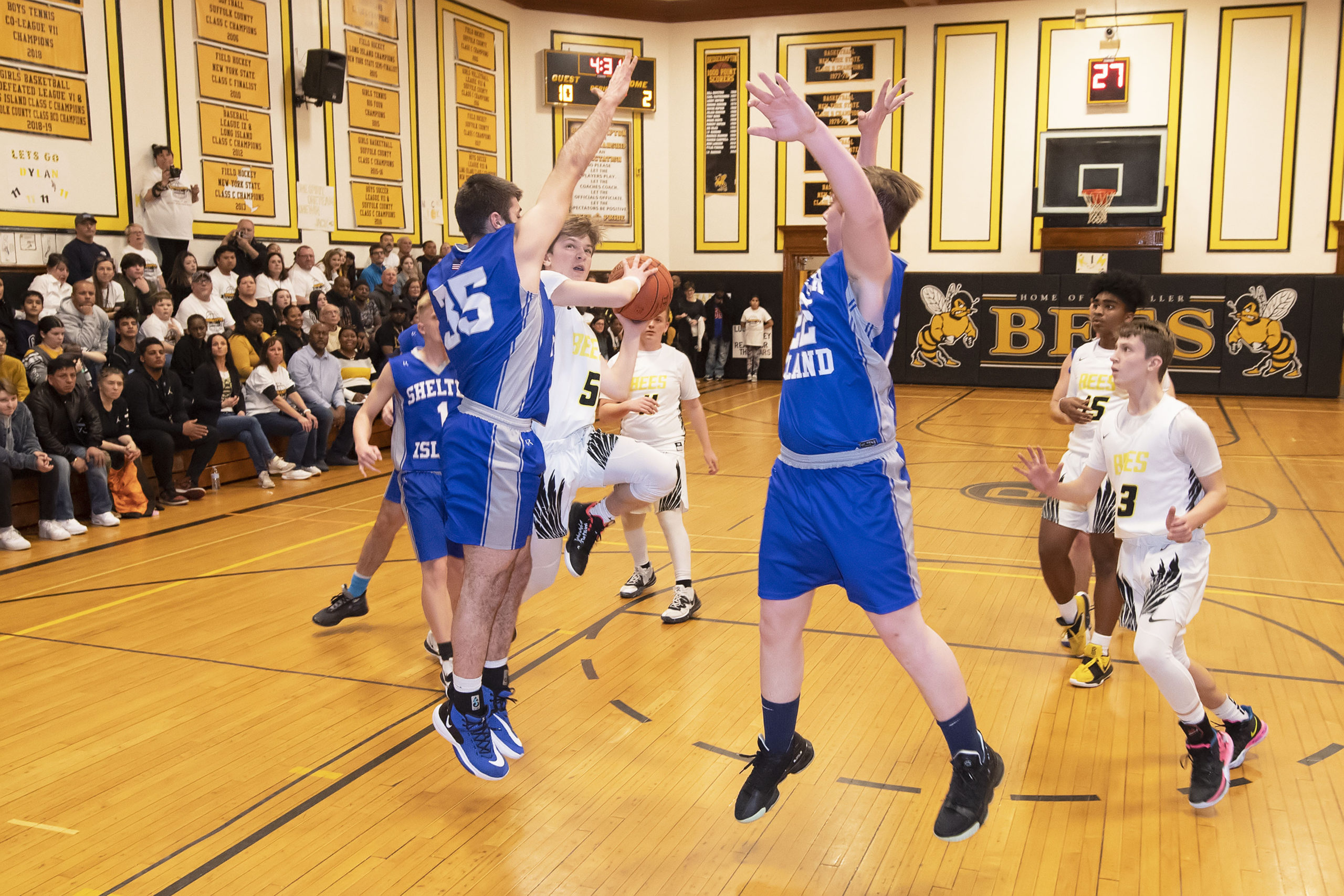 Bridgehampton freshman Scott Vinski takes on Shelter Island defenders in the paint. He scored 20 of the Bees' 40 points in last week's final game in The Hive.