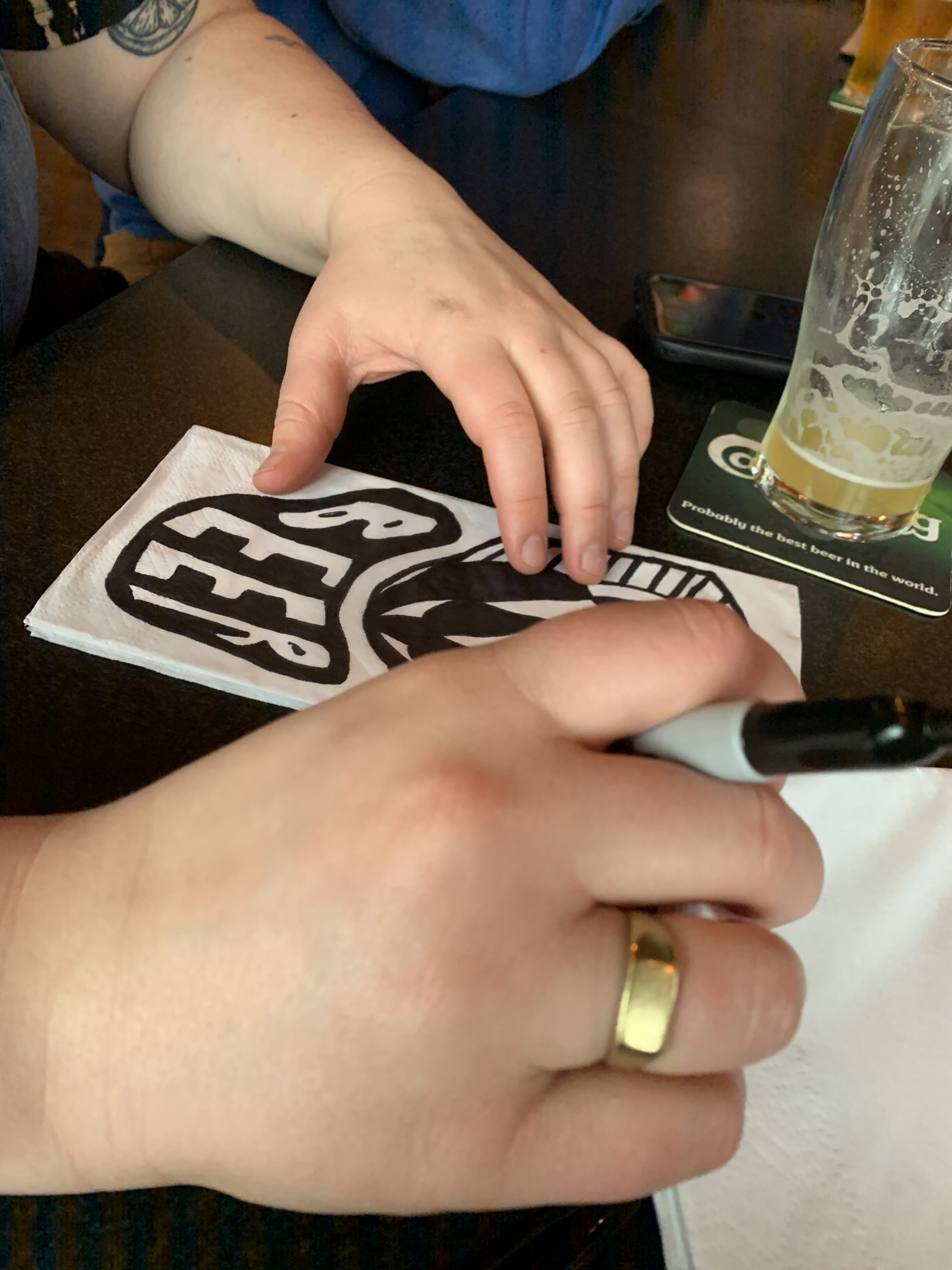 Brianna Ashe drawing on a napkin at Townline BBQ.