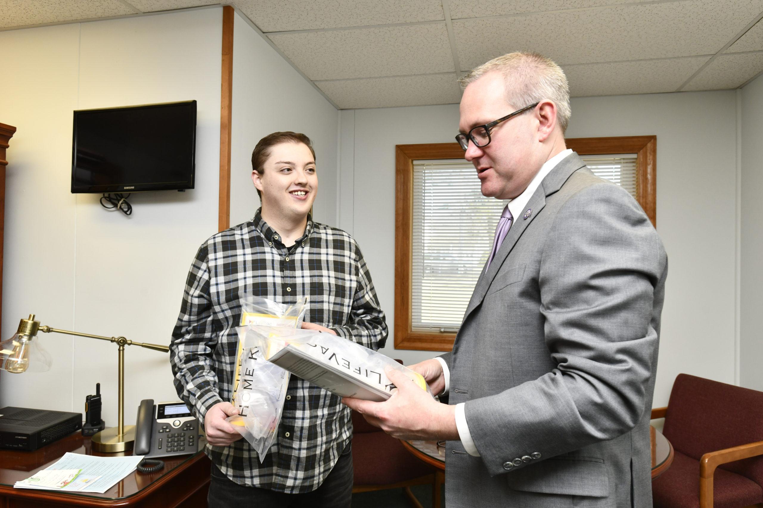 Dylan Musso delivers LifeVac kits to Hampton Bays Superintendent of Schools Lars Clemensen last week.   DANA SHAW