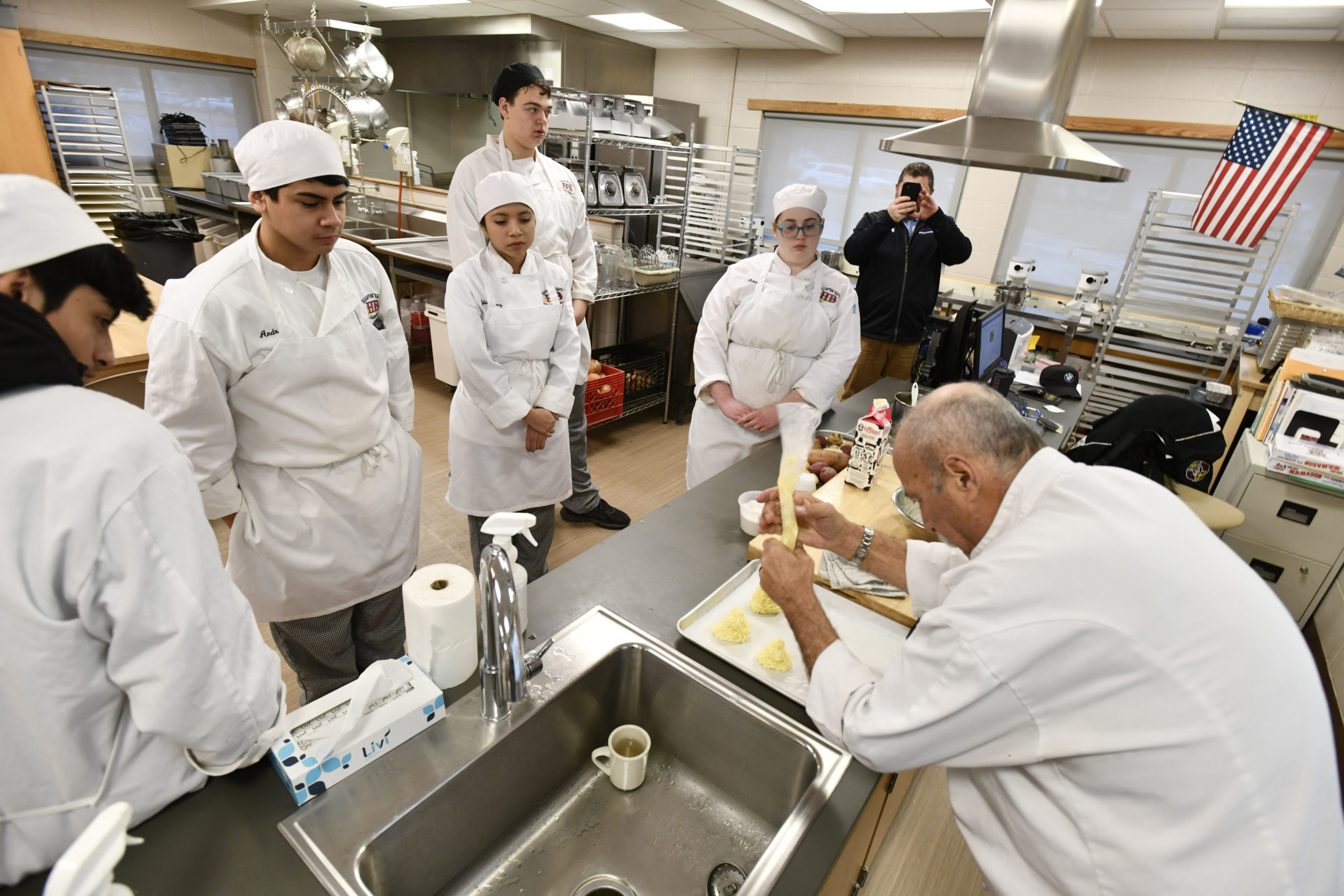 Chef Larry Weiss demonstrates the assignment during the culinary class at Hampton Bays High School on Thursday, February 6. DANA SHAW