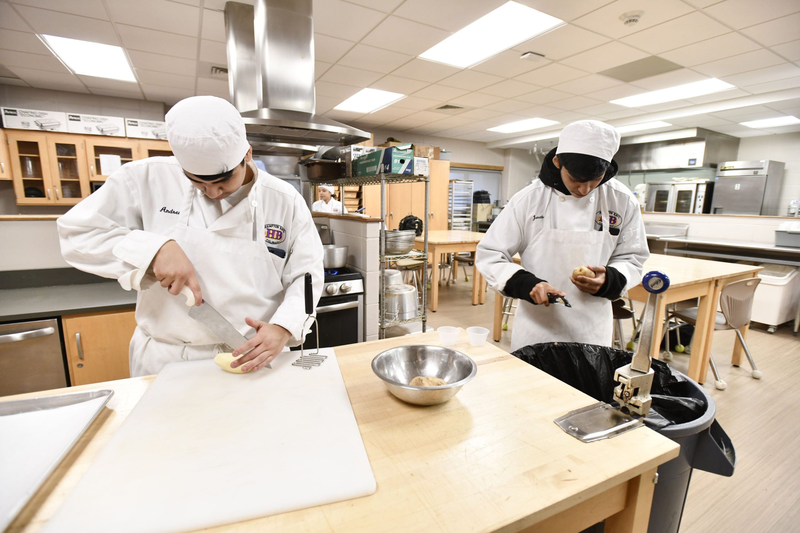 Students Andrew Avila and Jonathan Aquilar at work in the kitchen during the culinary class at Hampton Bays High School.  DANA SHAW