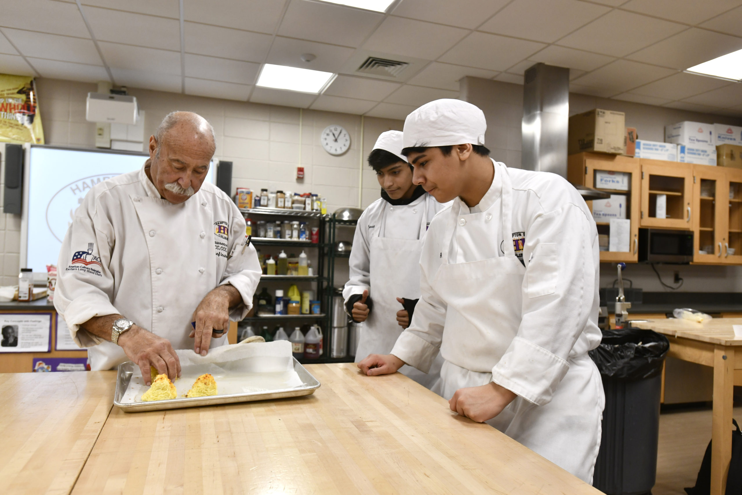 Chef Larry Weiss works with his students during the culinary class at Hampton Bays High School on Thursday, February 6. DANA SHAW