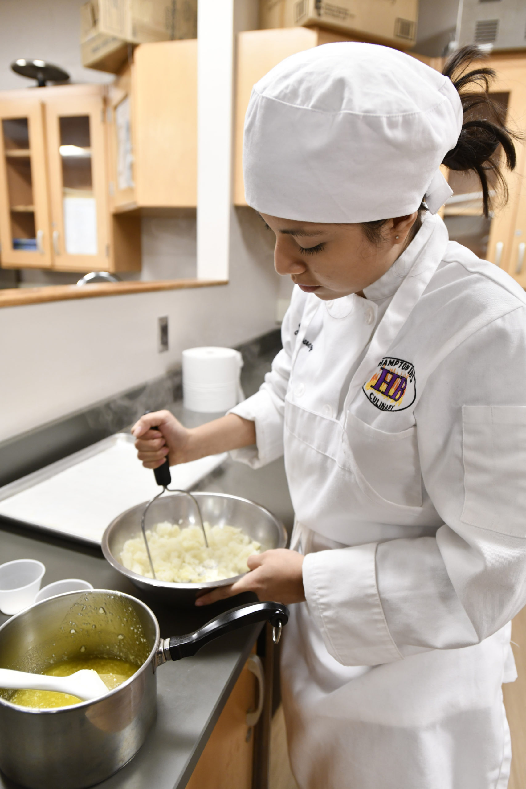 Student Juliana Alvarez works on and assignment during the culinary class at Hampton Bays High School. DANA SHAW