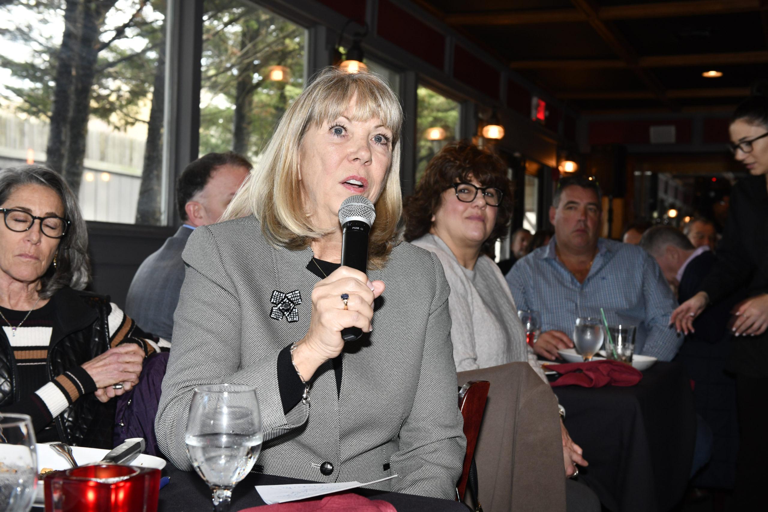 Susan von Freddi, president of the Hampton Bays Beautification Association puts a question to the panel.  DANA SHAW