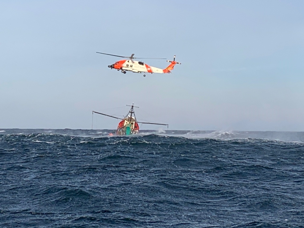 A United States Coast Guard helicopter comes to the aid of the New Age about 25 miles off Fire Island on February 12. COURTESY U.S. COAST GUARD