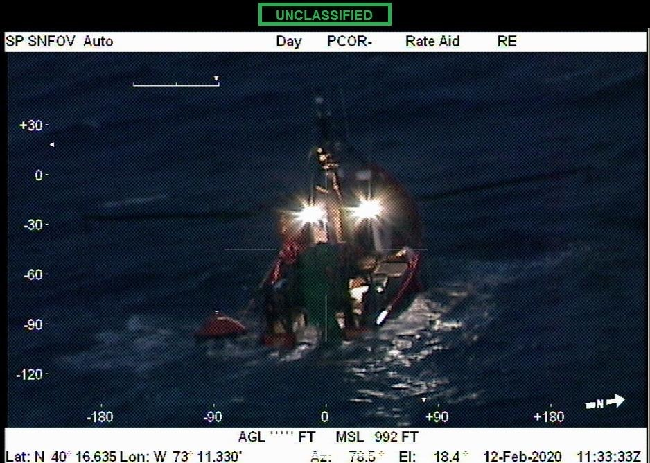 The partially submerged New Age as seen from a U.S. Coast Guard rescue helicopter. COURTESY U.S. COAST GUARD