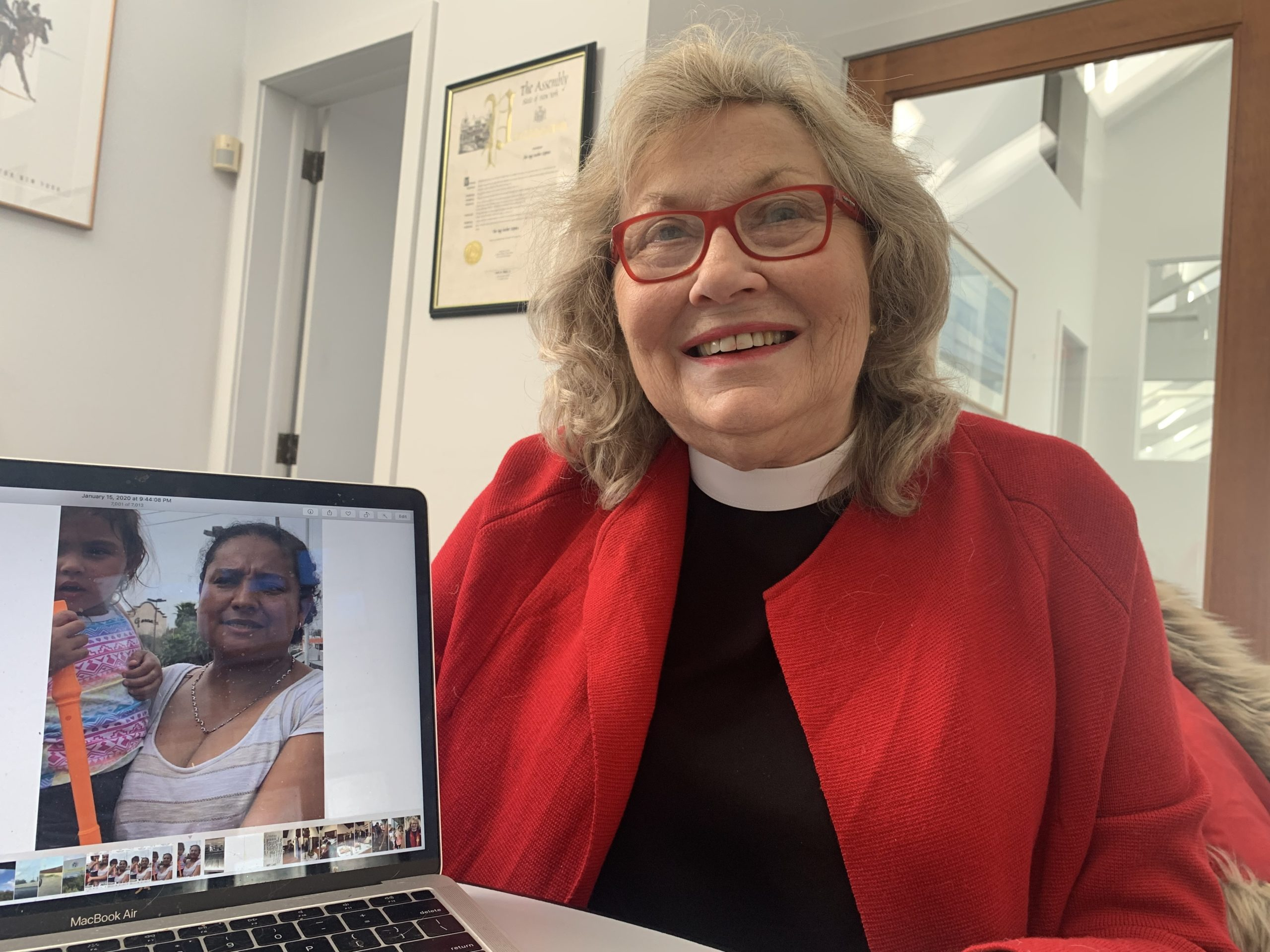 Rev. Karen Ann Campbell with a picture of JoAnna, a mother from Honduras, with her daughter, Italia, in Brownsville, Texas.