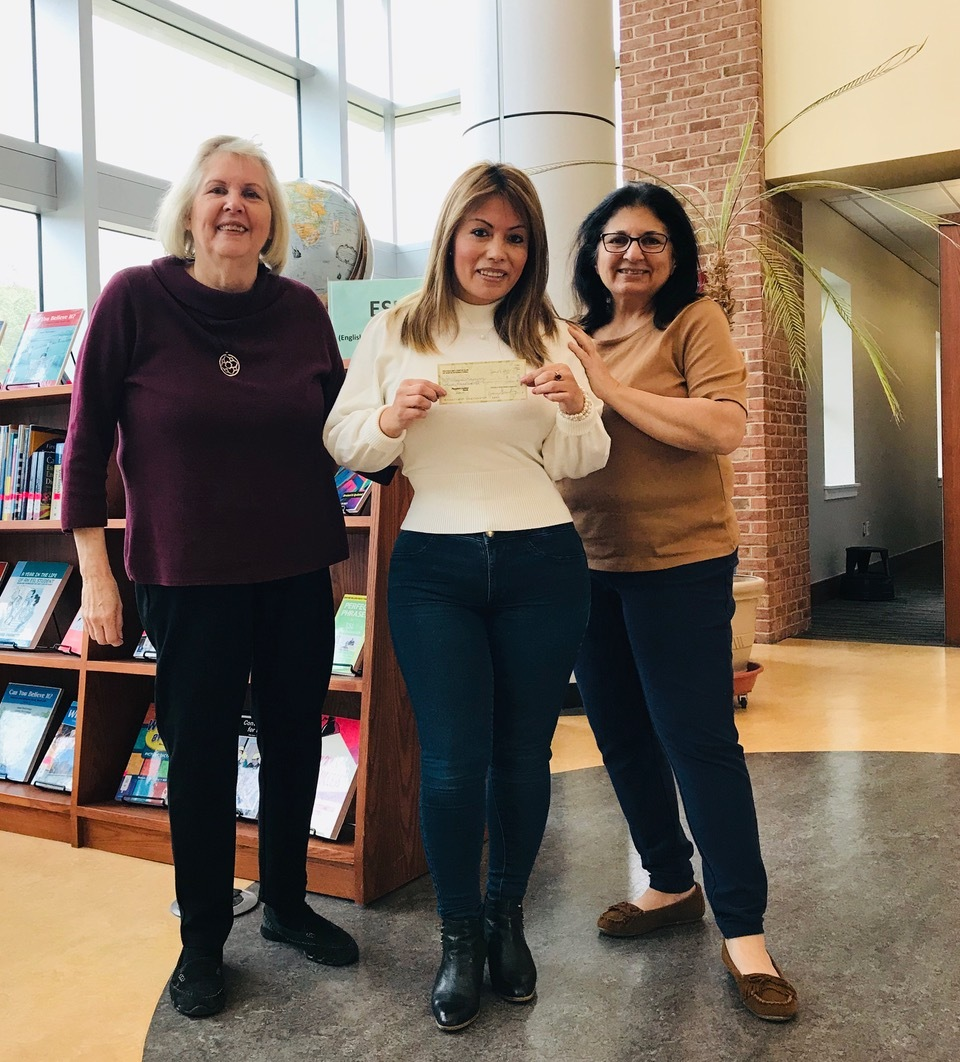 """Wilma Ramirez, center, of Hampton Bays won a $300 scholarship from Peconic Bay Zonta, a nonprofit group that works to improve the status of women and girls. Peconic Bay Zonta members Diane Greenberg, left, and Liala Strotman joined Ms. Ramirez at Suffolk County Community College, where she successfully completed level 3 of the school's English as a Second Language program (ESL). The local Zonta group awards the scholarship biannually to a student in the ESL program who is studying to achieve an educational goal. Born in Ecuador, Ms. Ramirez came to the U.S. as a teenager and completed high school locally. Currently, her dream is to attend college. She said, """"I enrolled in the ESL program because after being in this country for 26 years and working hard to put my three children through college, it's finally my turn to go back to school."""" Ms. Ramirez, a single mother whose children are now age 26, 21 and 18, currently employs three people in a company she started called Wilma's Cleaning Service Corporation. While she is proud of her accomplishments so far, she is motivated to improve her skills. """"I want to better myself, not only for me but to show my children that you can set goals and achieve them at any point in life."""" Peconic Bay Zonta covers the East End of Long Island and is affiliated with Zonta International, which works to empower women around the world through service and advocacy. For more information about the local Zonta group, see http://peconicbayzonta.blogspot.com."""