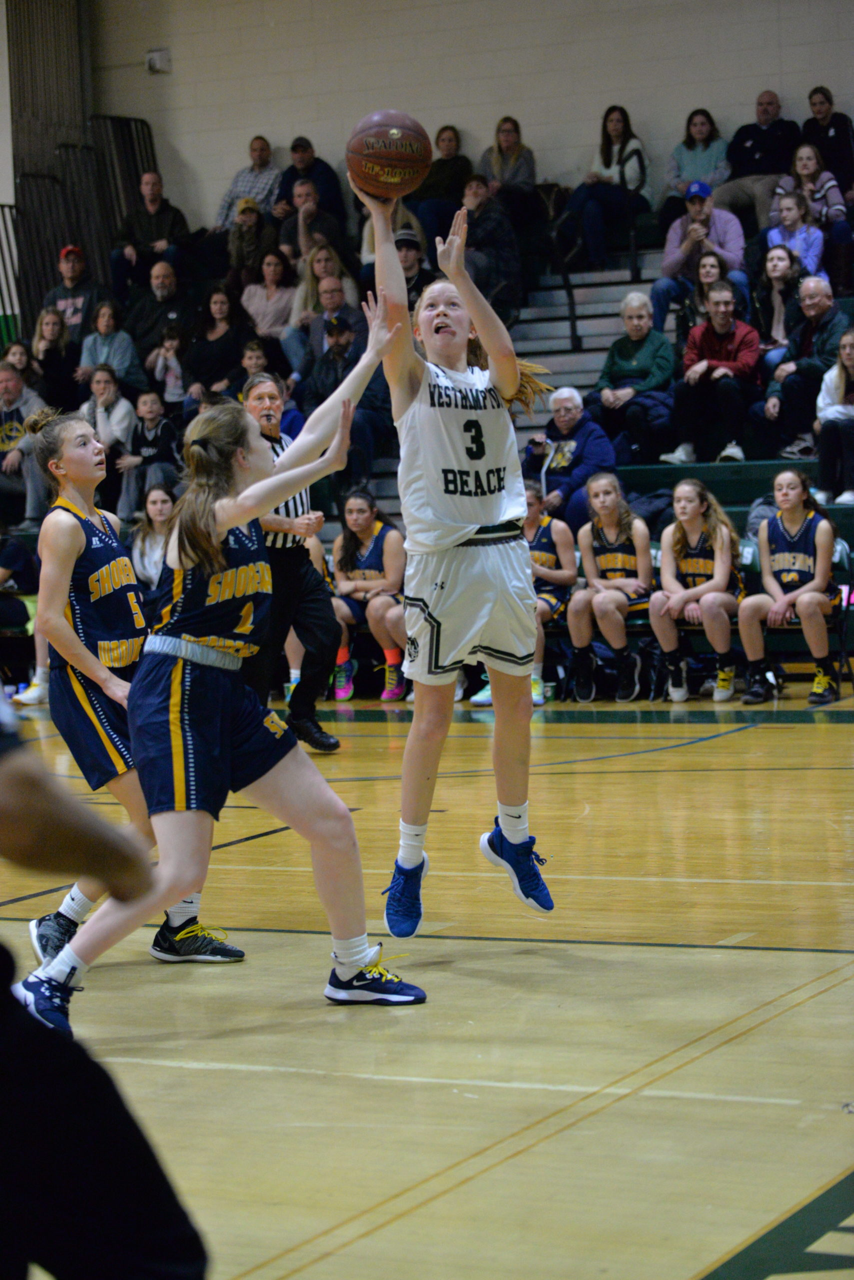 Lady Hurricane Molly McCarthy goes up with a shot.