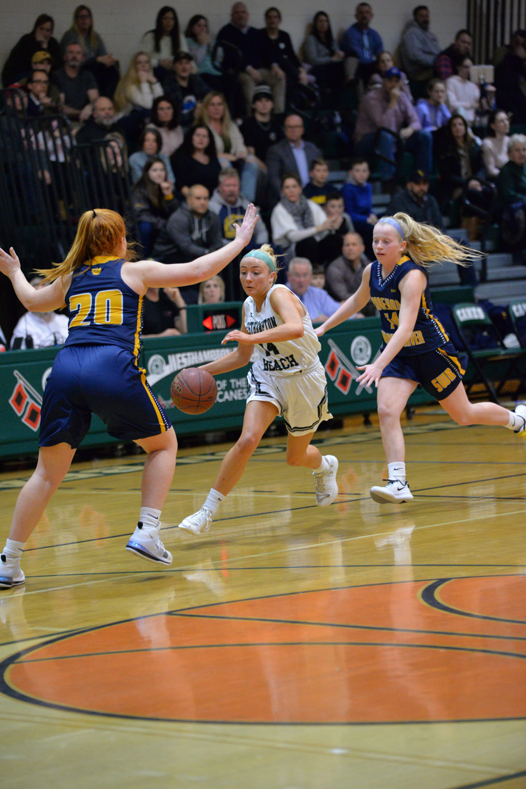 Caroline Henke of Westhampton Beach brings the ball upcourt.