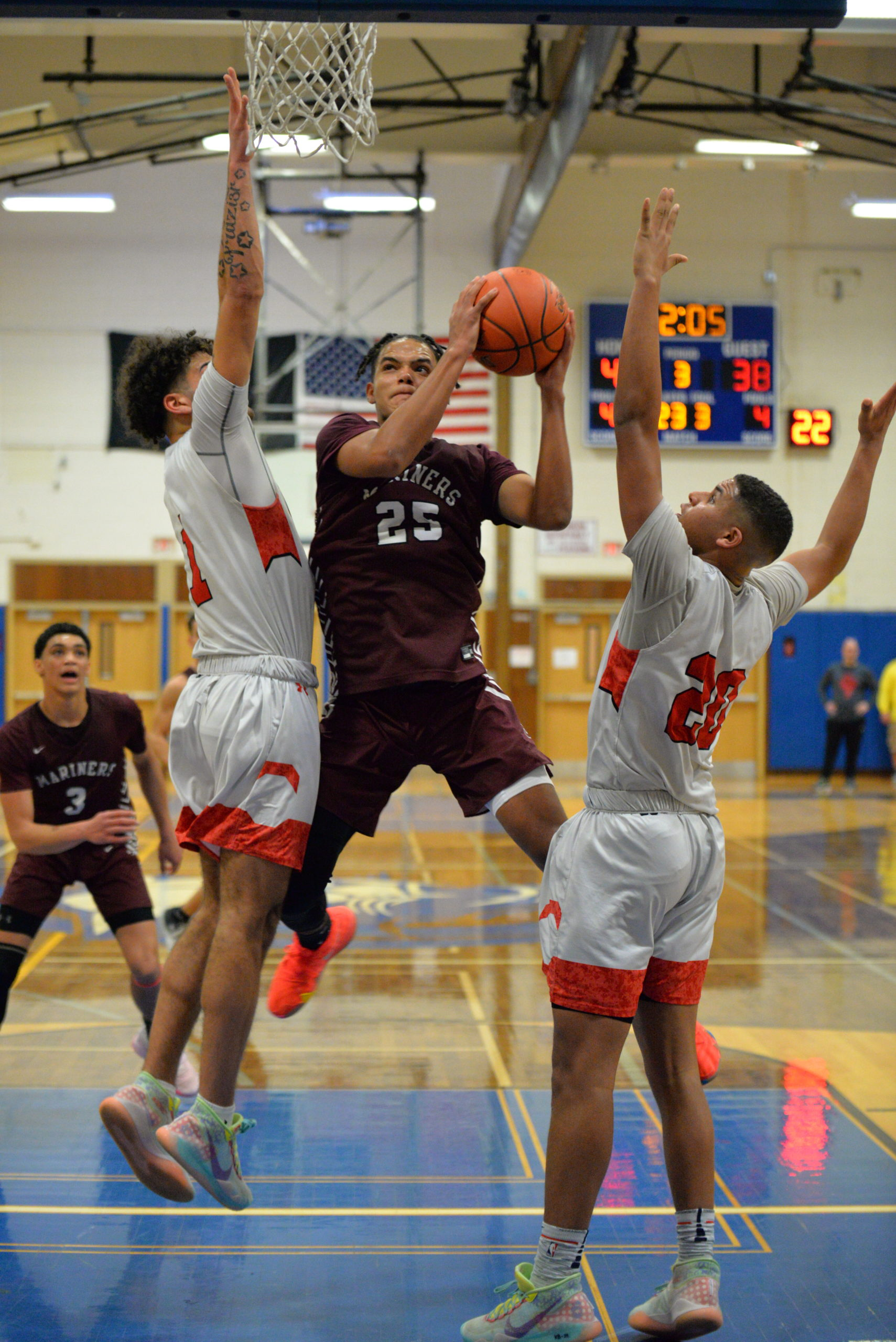 Southampton sophomore LeBron Napier tries to avoid a pair of Center Moriches defenders in the paint.