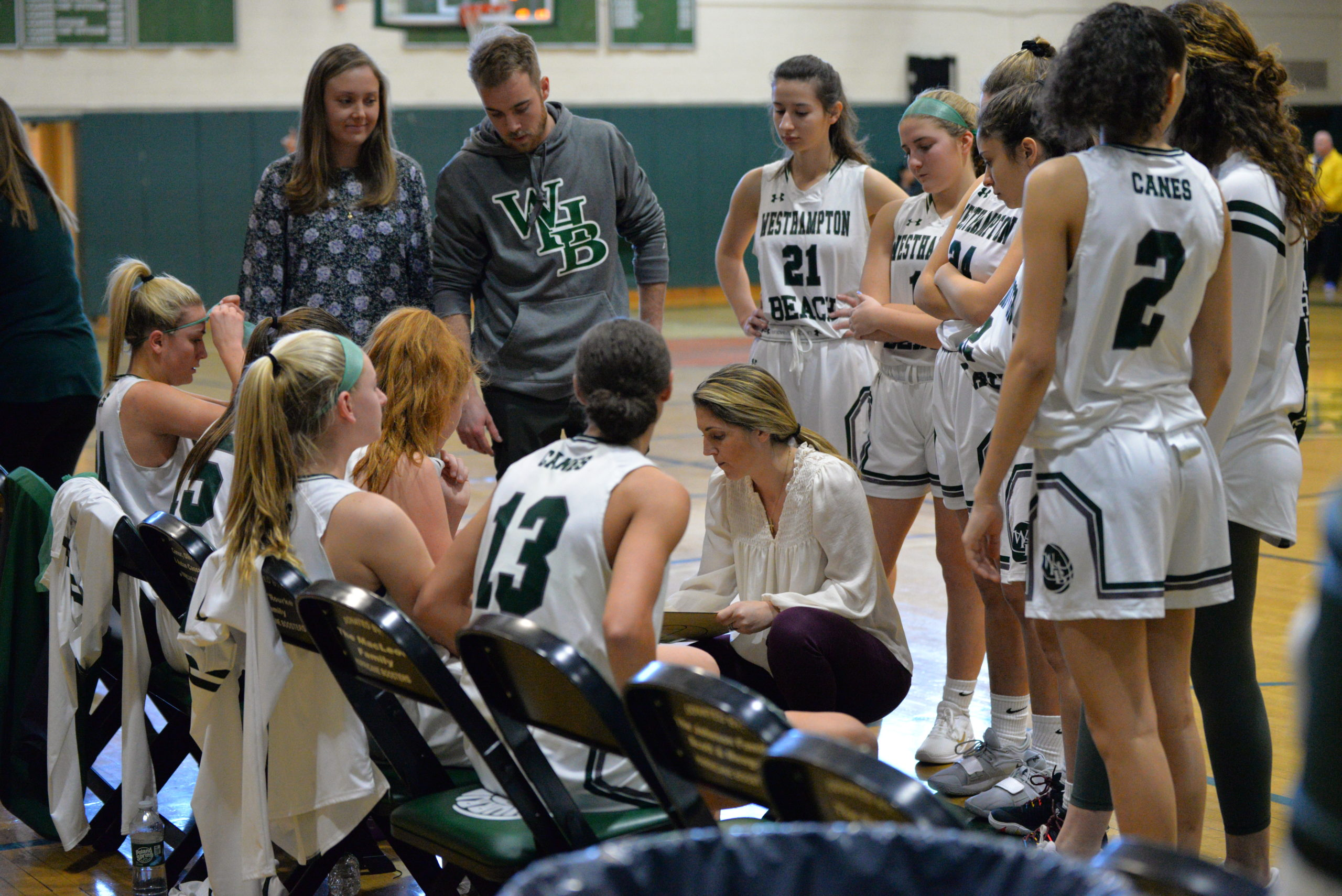 Westhampton Beach head coach Katie Peters goes over some strategy with her players during a time out.