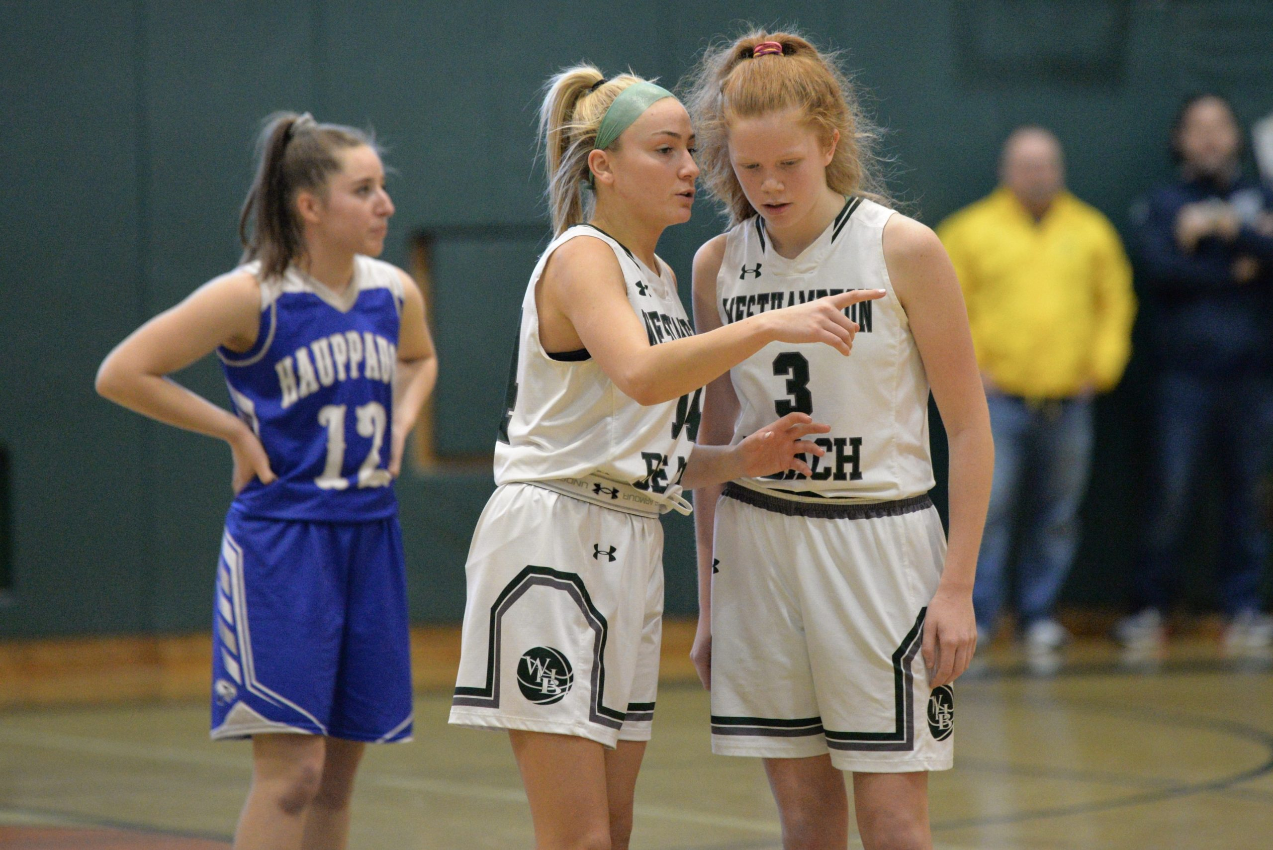 Westhampton Beach senior Isabelle Smith shares a few pointers with sophomore Molly McCarthy.