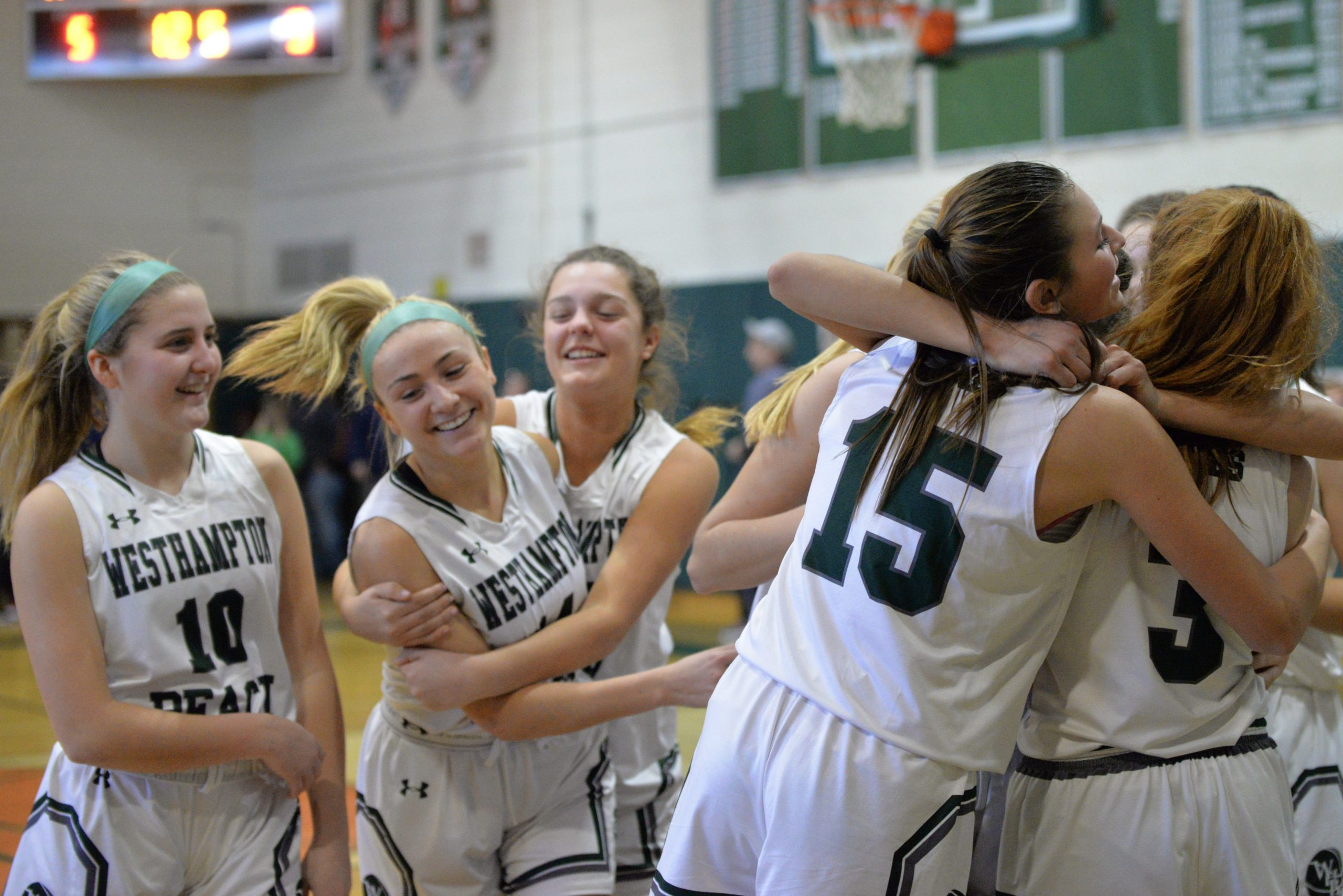 The Lady Canes are all smiles after defeating Hauppauge in the county semis on Friday afternoon.