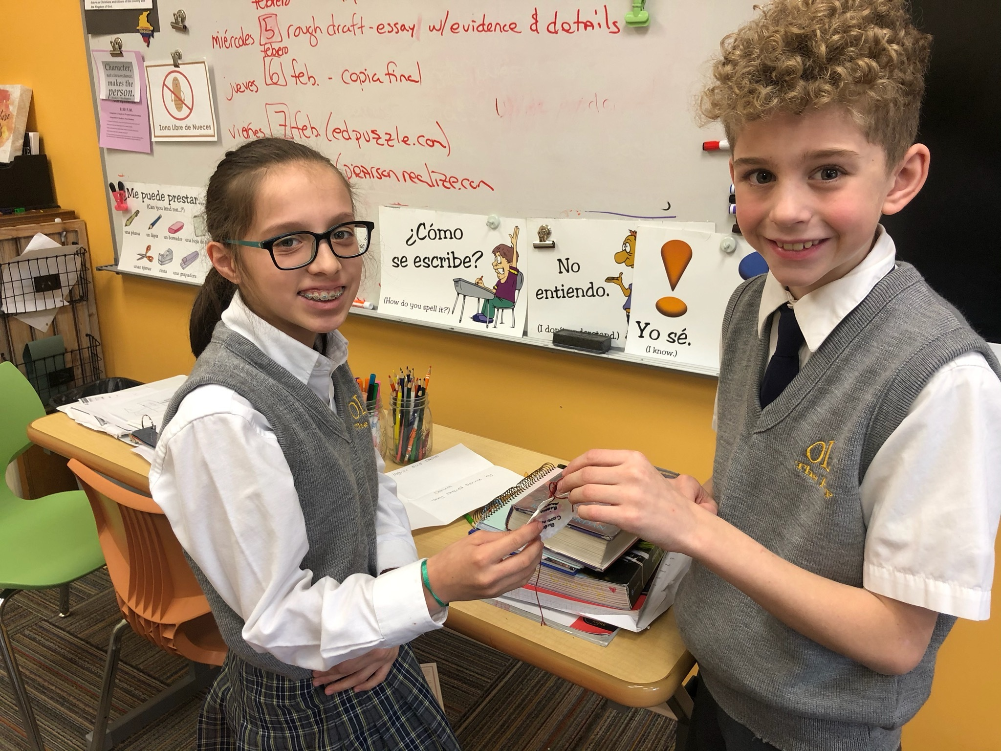 Our Lady of the Hamptons School sixth-graders Bianca Alvarado and Brian Spellman helped to prepare the identification shells for the pilgrimage project. The mock pilgramage is the culmination of an integrated Spanish, religion, art, history, and geography project.