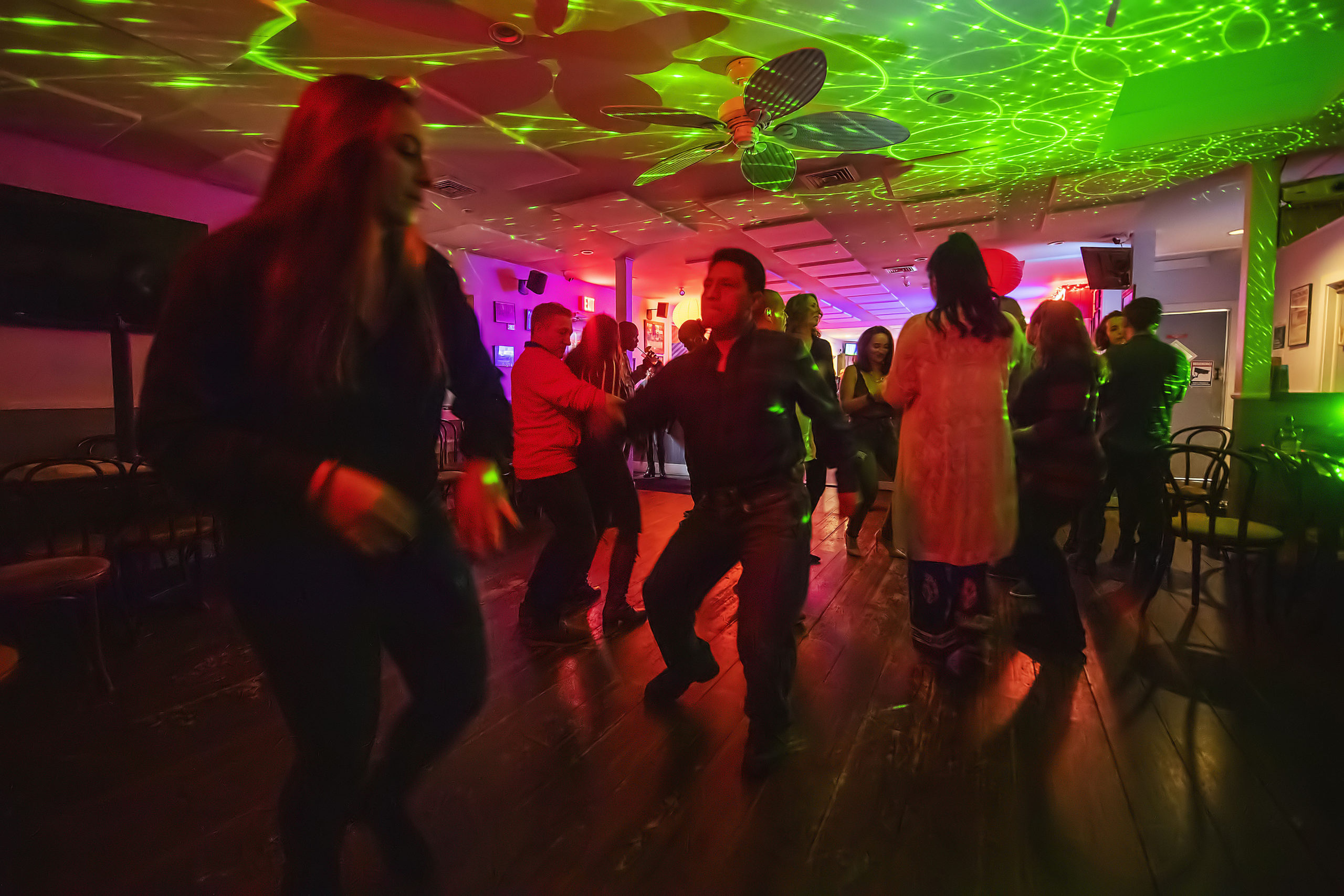 Supporters of ProjectMost on the dance floor during a Salsa Dance Party  at the Springs Tavern on Saturday night, January 25. MICHAEL HELLER
