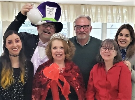 The Rogers Mansion Players, sponsored by the Village of Southampton and Southampton History Museum,  entertained guests at the Hamptons Center for Rehabilitation and Nursing last week. The Valentine Party featured The Queen of Hearts Georgette Chapek, center, along with, left to right,  Liana Mizzi, Mad Hatter Father Patrick Edwards, Tom Edmonds, Laurie Collins, and Southampton Village Trustee Kimberly Allen.
