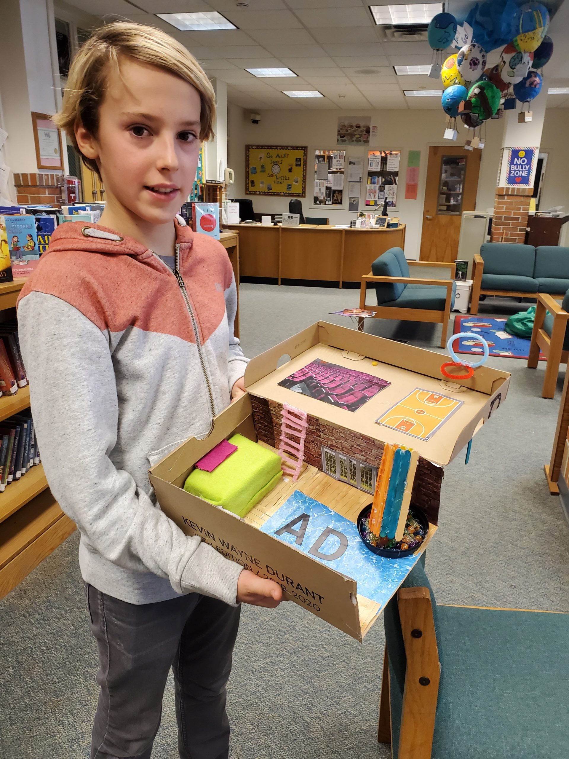 Westhampton Beach Middle School student Adrien Dellaert shows of his design, the result of a project in which students were asked to create their dream bedroom inside a shoebox.