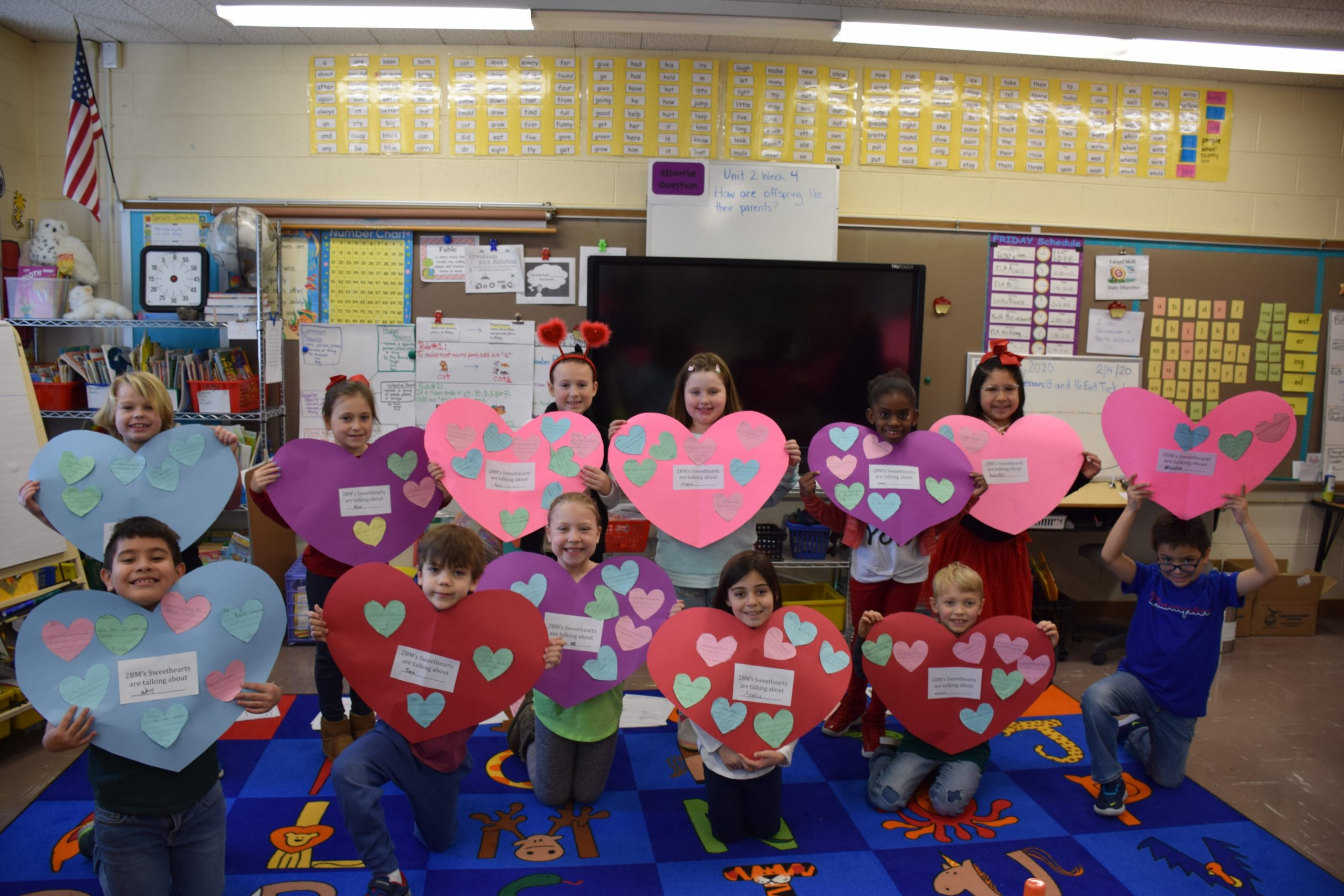 """Westhampton Beach Elementary School students were full of kind words on Valentine's Day as they completed a variety of educational projects. They made giant hearts filled with compliments to give to their classmates, designed Valentine's Day cards and, at the kindergarten level, worked on their writing skills by drawing on hearts using the """"at"""" word family, such as cat, bat, sat, and sight words."""